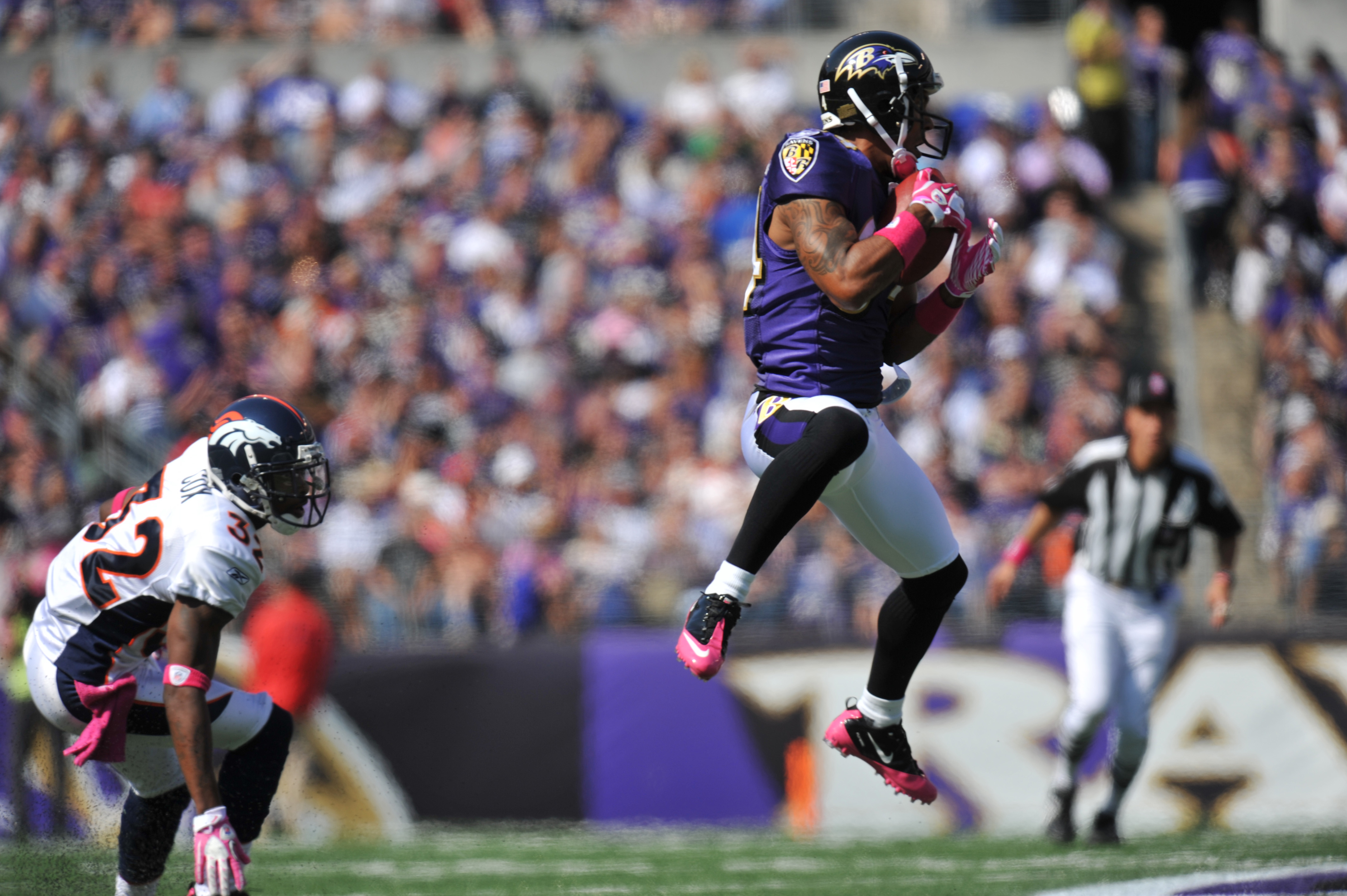 BALTIMORE, MD - OCTOBER 10:  T.J. Houshmandzadeh #84 of the Baltimore Ravens makes a catch against the Denver Broncos at M&T Bank Stadium on October 10, 2010 in Baltimore, Maryland. Players wore pink in recognition of Breast Cancer Awareness Month. The Ra