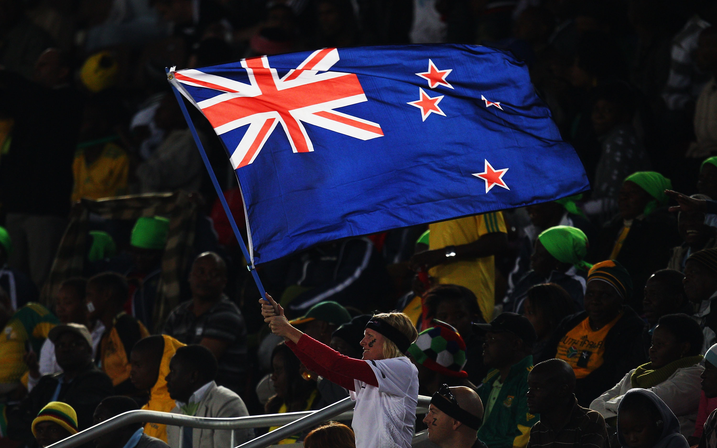 POLOKWANE, SOUTH AFRICA - JUNE 24:  A New Zealand flag waves her national flag during the 2010 FIFA World Cup South Africa Group F match between Paraguay and New Zealand at Peter Mokaba Stadium on June 24, 2010 in Polokwane, South Africa.  (Photo by Camer