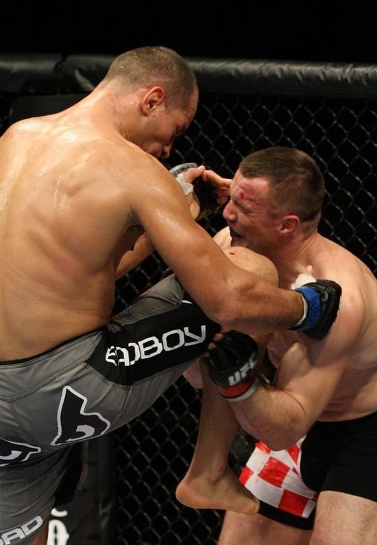 Dos Santos (left) nails Mirko Cro Cop with a knee.