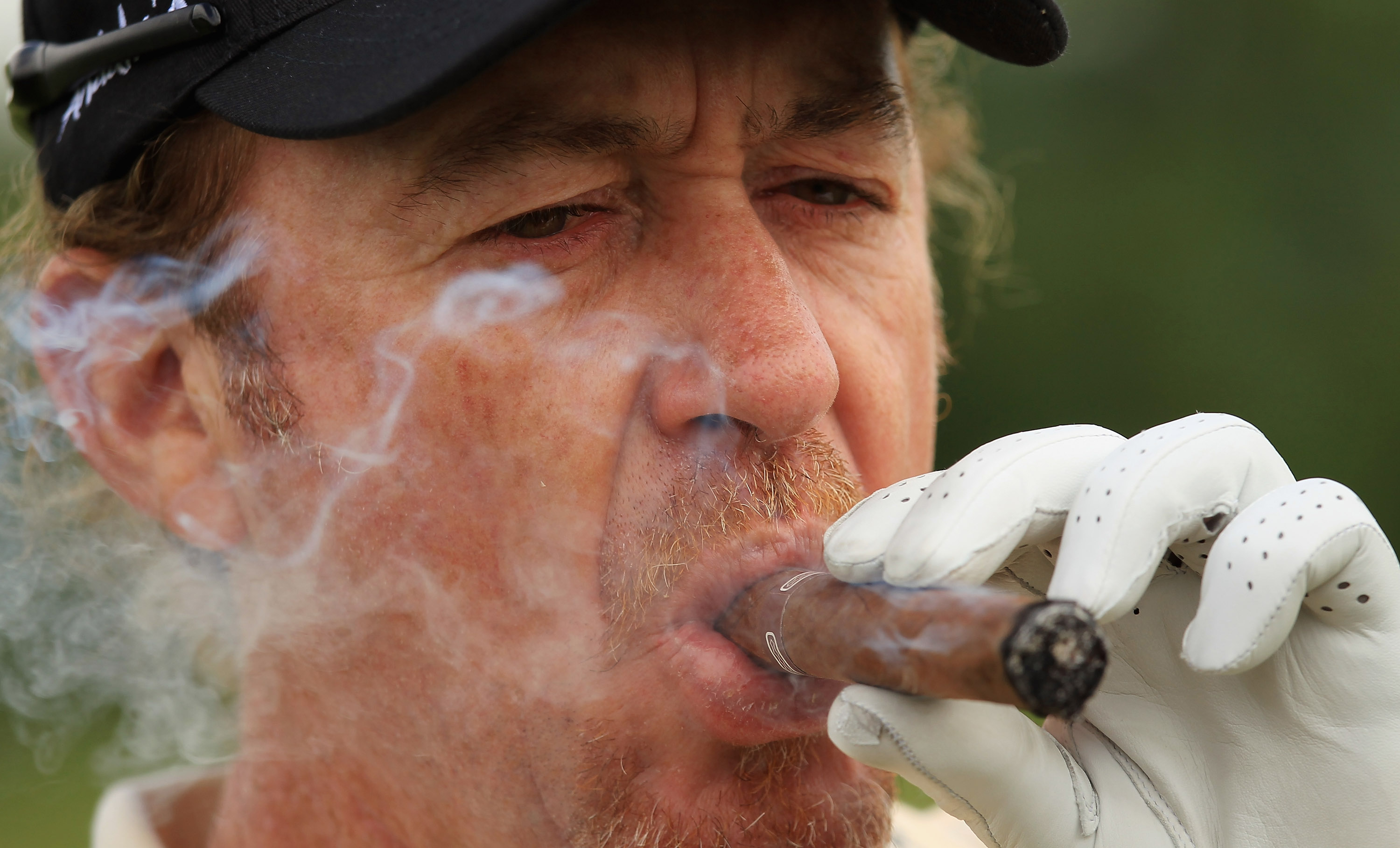 NEWPORT, WALES - JUNE 02:  Miguael Angel Jimenez of Spain lights up a cigar on the second tee during the Pro-Am for the Celtic Manor Wales Open on The Twenty Ten Course on June 2, 2010 in Newport, Wales.  (Photo by Warren Little/Getty Images)