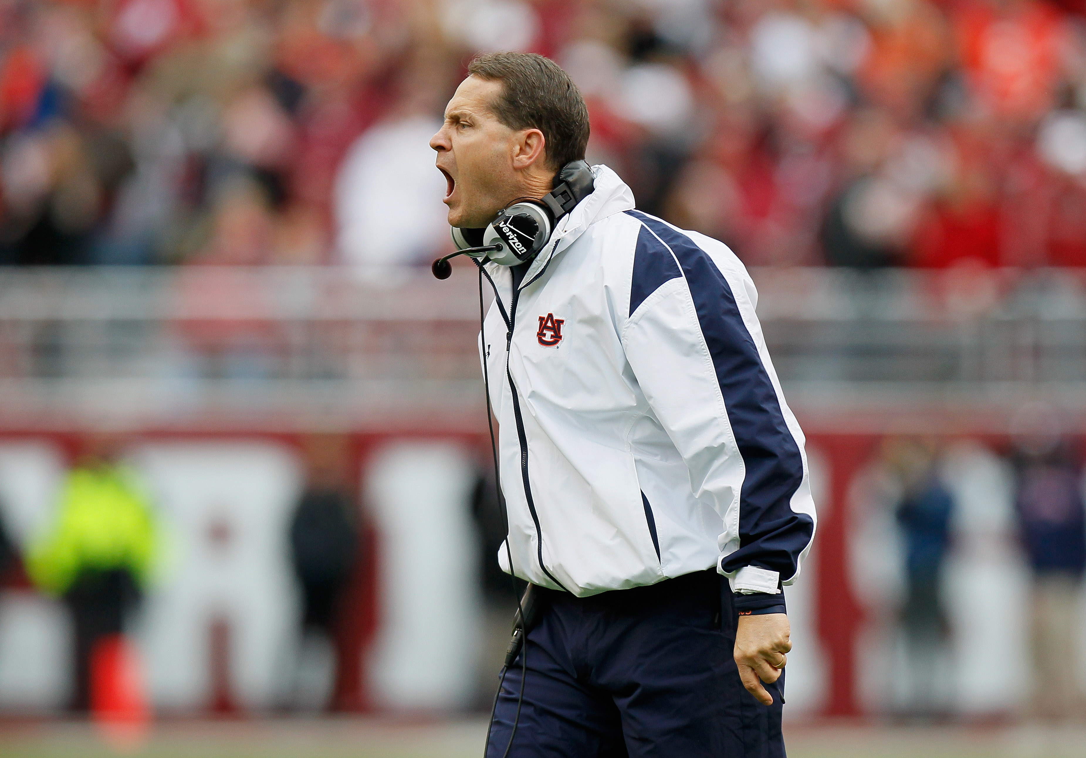 TUSCALOOSA, AL - NOVEMBER 26:  Head coach Gene Chizik of the Auburn Tigers yells to his defense during the game against the Alabama Crimson Tide at Bryant-Denny Stadium on November 26, 2010 in Tuscaloosa, Alabama.  (Photo by Kevin C. Cox/Getty Images)