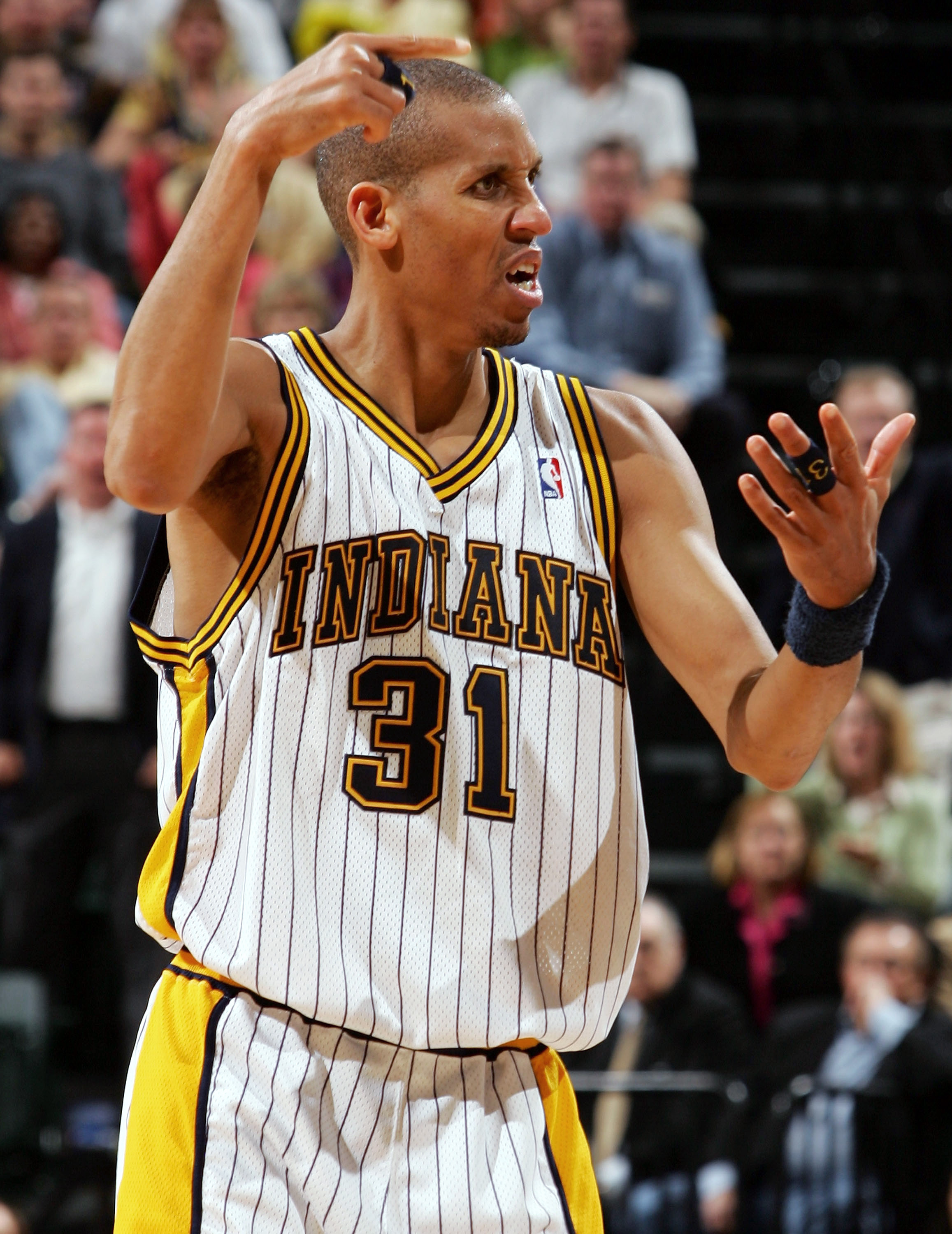 61230f0d92f INDIANAPOLIS - MAY 15  Reggie Miller  31 of the Indiana Pacers reacts to a