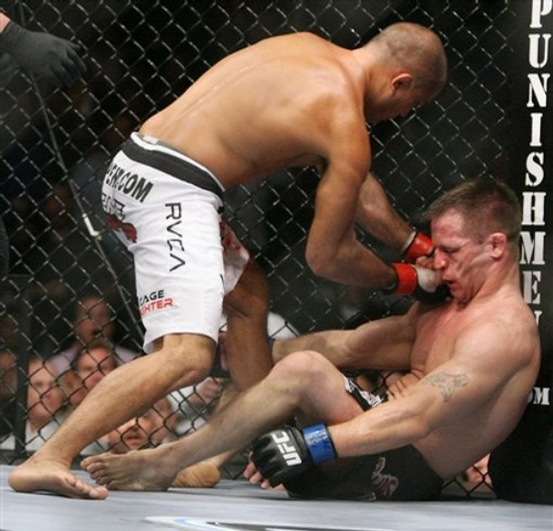 BJ Penn landing a shot to Sean Sherk's face after he flying-kneed him in the face.