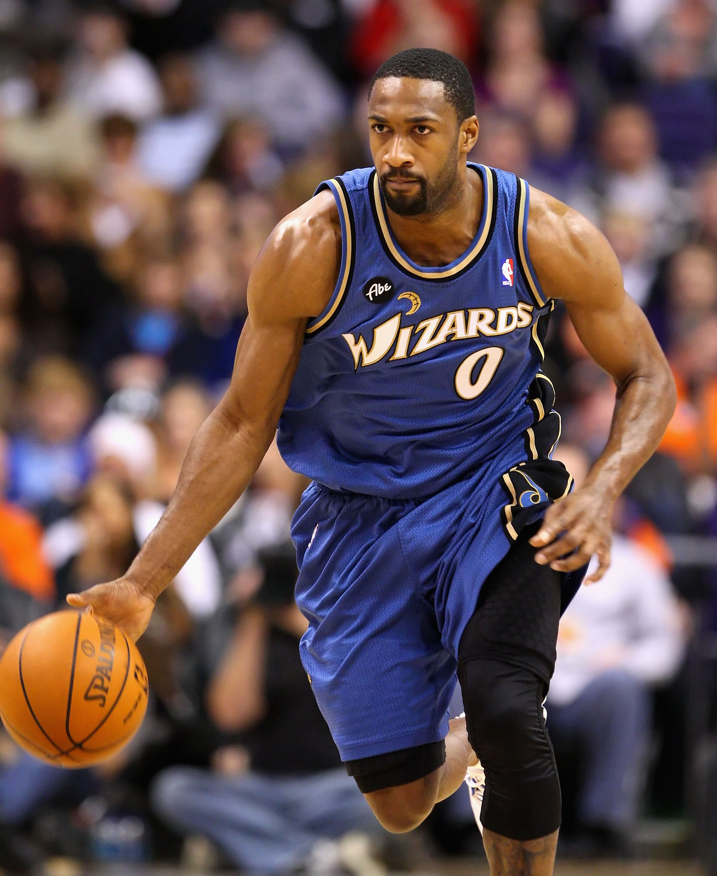 PHOENIX - DECEMBER 19:  Gilbert Arenas #0 of the Washington Wizards hanldles the ball during the NBA game against the Phoenix Suns at US Airways Center on December 19, 2009 in Phoenix, Arizona. The Suns defeated the Wizards 121-95. NOTE TO USER: User expr