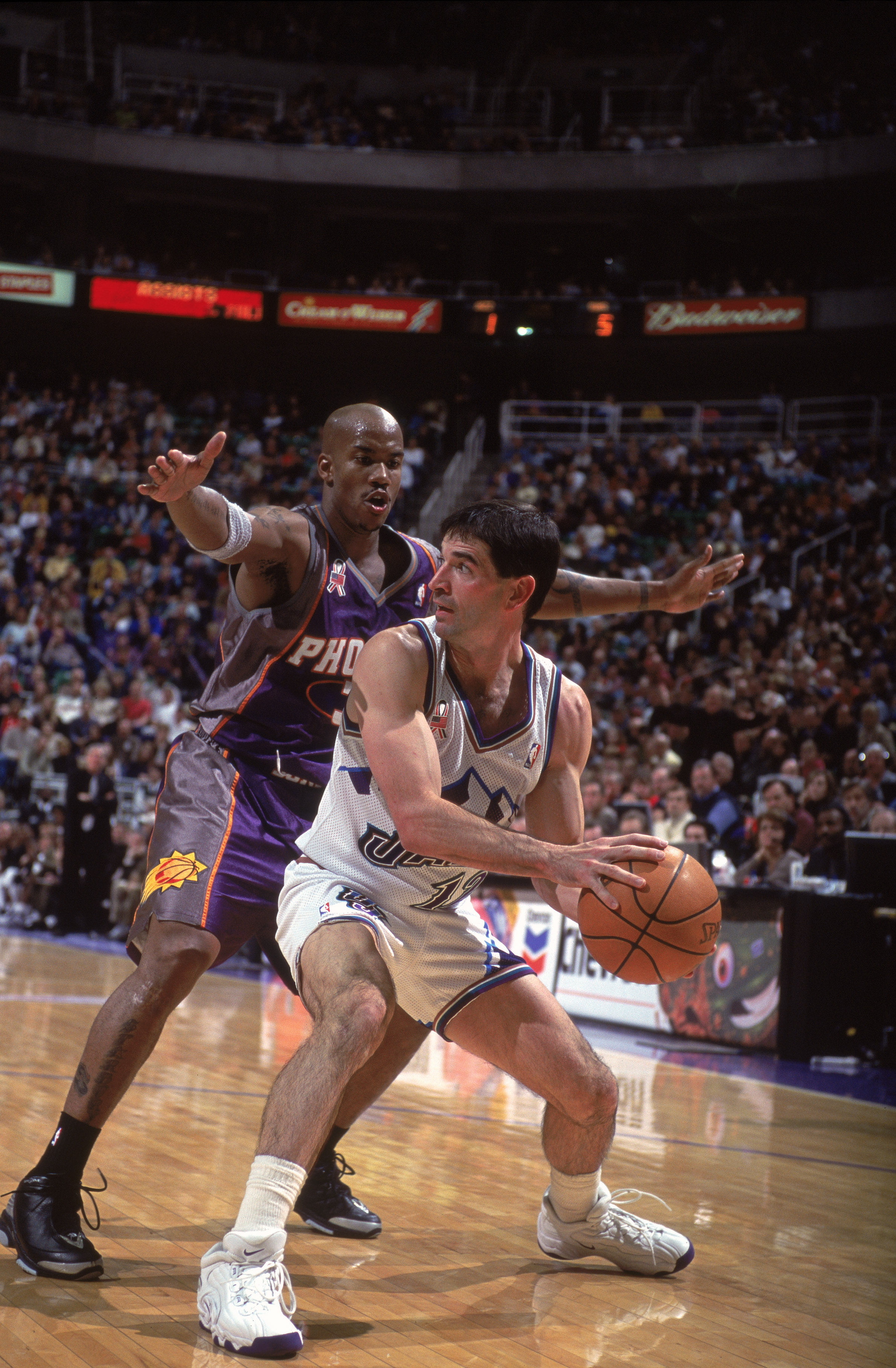 26 Nov 2001:  John Stockton #12  of the Utah Jazz looks to move the ball as he is guarded by Stephon Marbury #3 of the Phoenix Suns during the game at the Delta Center in Salt Lake City, Utah. The Suns defeated the Jazz 111-104. NOTE TO USER: User express