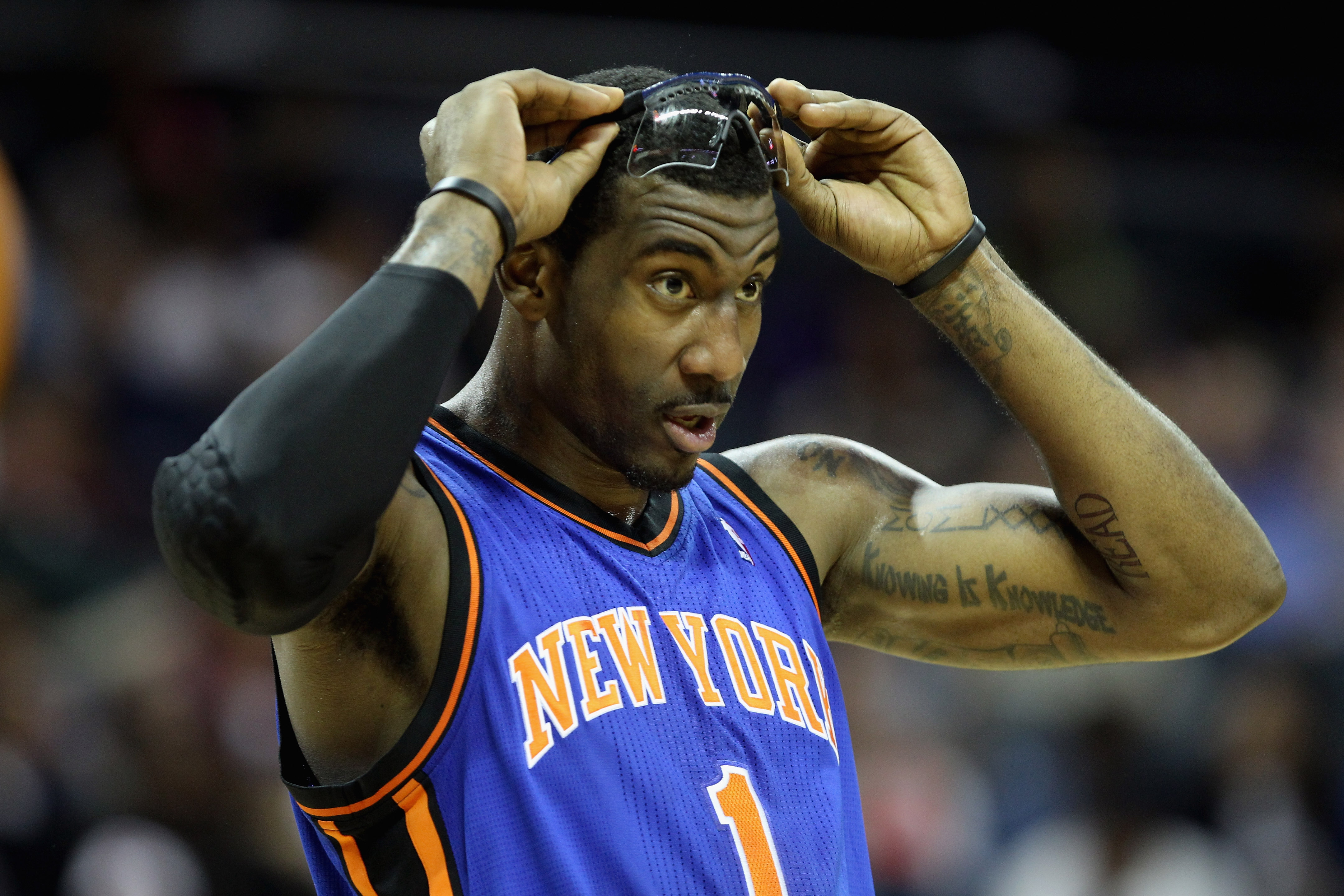 CHARLOTTE, NC - NOVEMBER 24:  Amare Stoudemire #1 of the New York Knicks watches on during his game against the Charlotte Bobcats at Time Warner Cable Arena on November 24, 2010 in Charlotte, North Carolina.  NOTE TO USER: User expressly acknowledges and