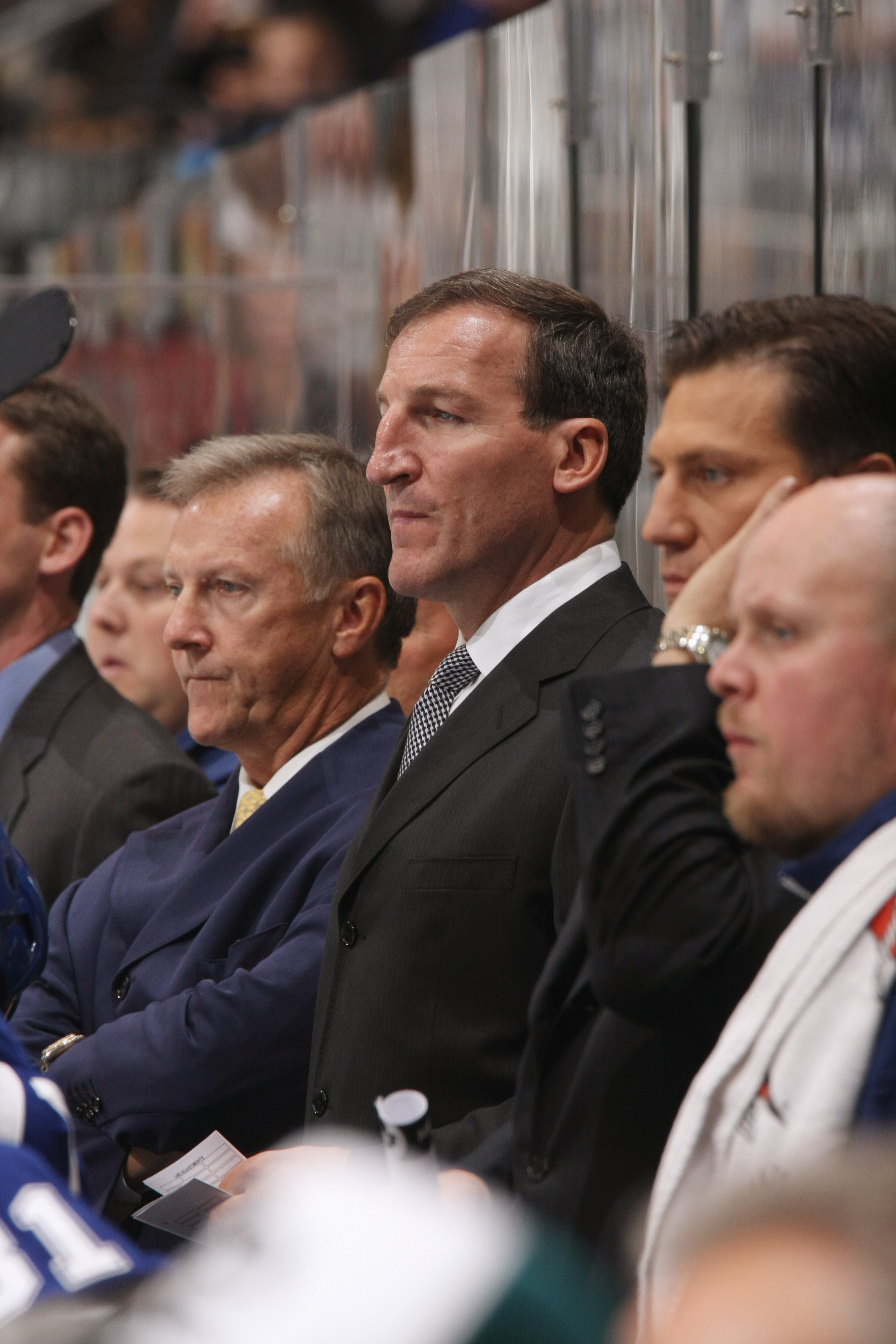 TORONTO - SEPTEMBER 22:  Assistant Coach Tim Hunter and Head Coach Ron Wilson of the Toronto Maple Leafs looks on against the Buffalo Sabres during their pre season NHL game at the Air Canada Centre on September 26, 2008 in Toronto, Ontario, Canada. (Phot