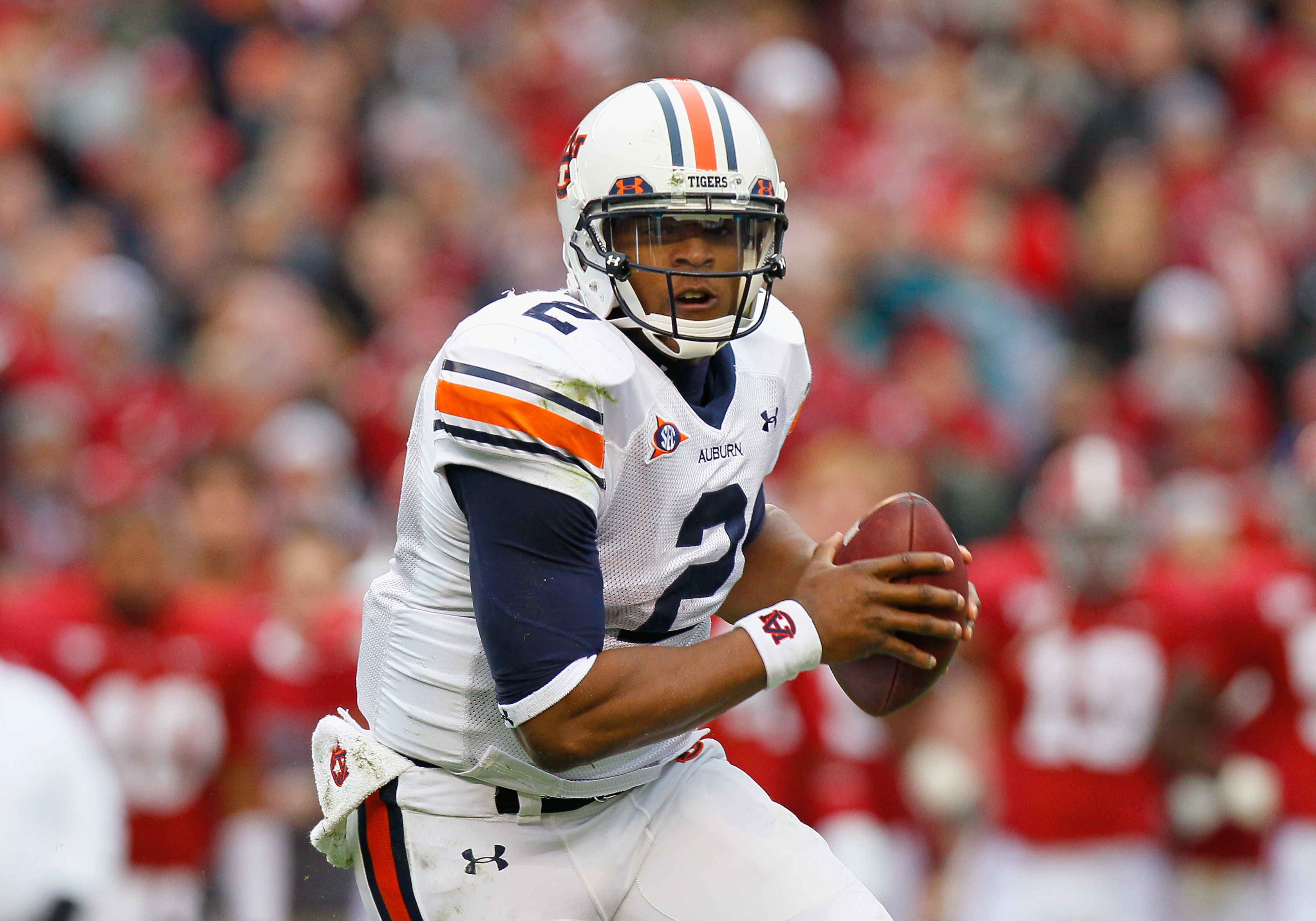 TUSCALOOSA, AL - NOVEMBER 26:  Quarterback Cam Newton #2 of the Auburn Tigers rushes out of the pocket against the Alabama Crimson Tide at Bryant-Denny Stadium on November 26, 2010 in Tuscaloosa, Alabama.  (Photo by Kevin C. Cox/Getty Images)