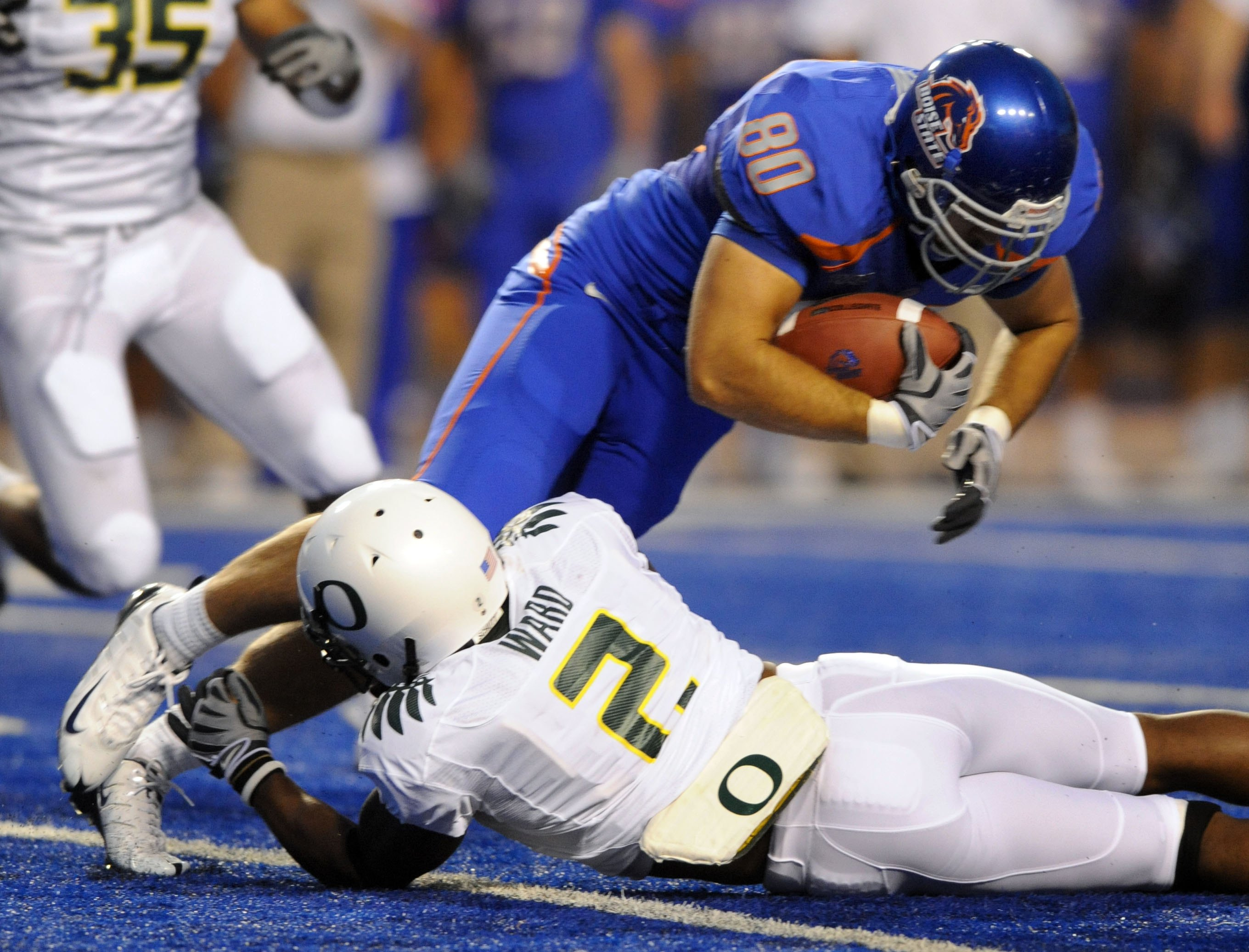 BOISE, ID - SEPTEMBER 3: Safety T.J Ward #2 of the Oregon Ducks  tackles tight end Kyle Efaw #80 of the Boise State Broncos in the second quarter of the game on September 3, 2009 at Bronco Stadium in Boise, Idaho. Boise State won the game 19-8. (Photo by