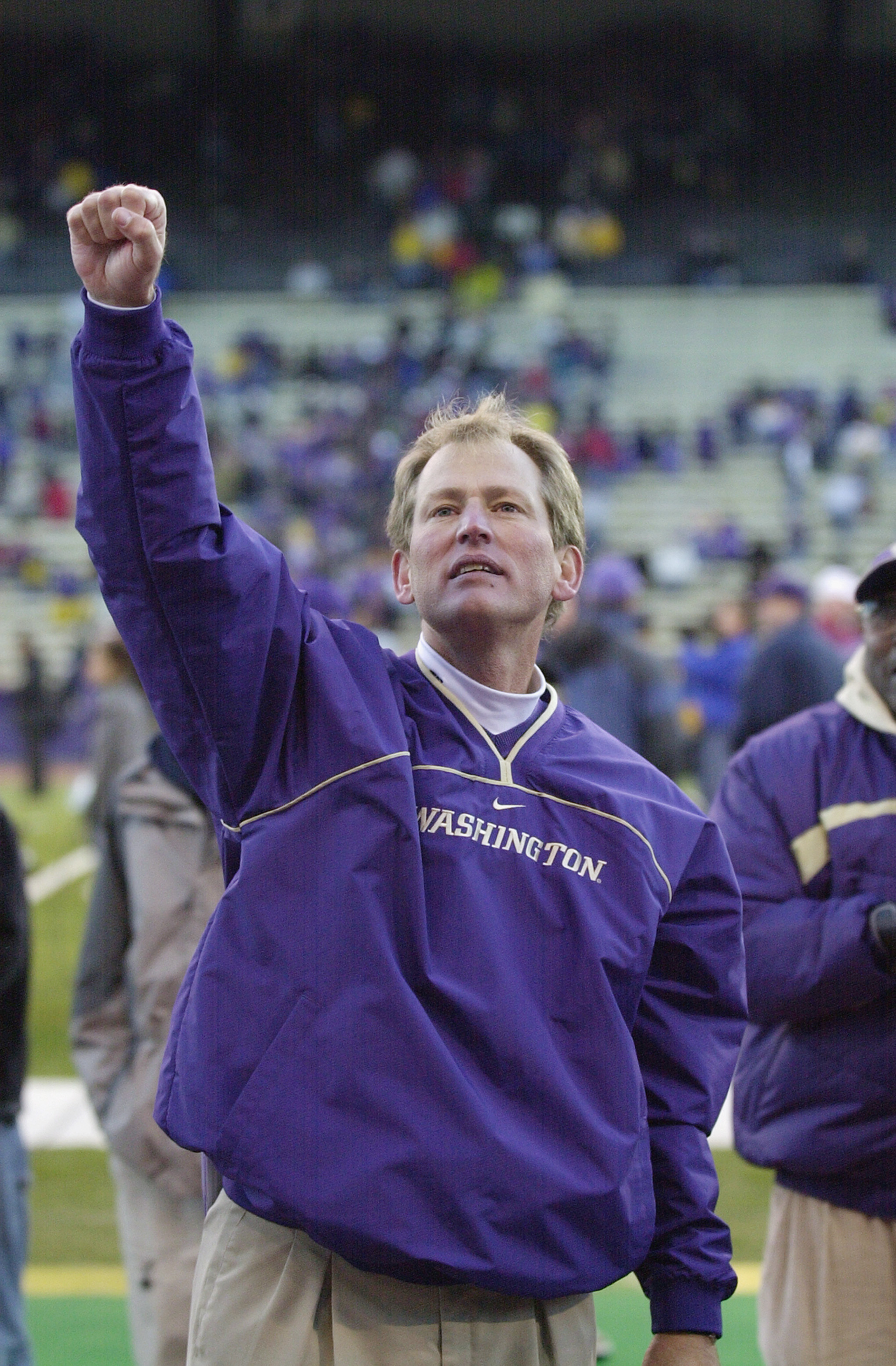 SEATTLE - NOVEMBER 17:  Head coach Rick Neuheisel of the Washington Huskies celebrates after winning the Pac-10 Conference football game against the Washington State Cougars on November 17, 2001 at Husky Stadium in Seattle, Washington. The Huskies defeate