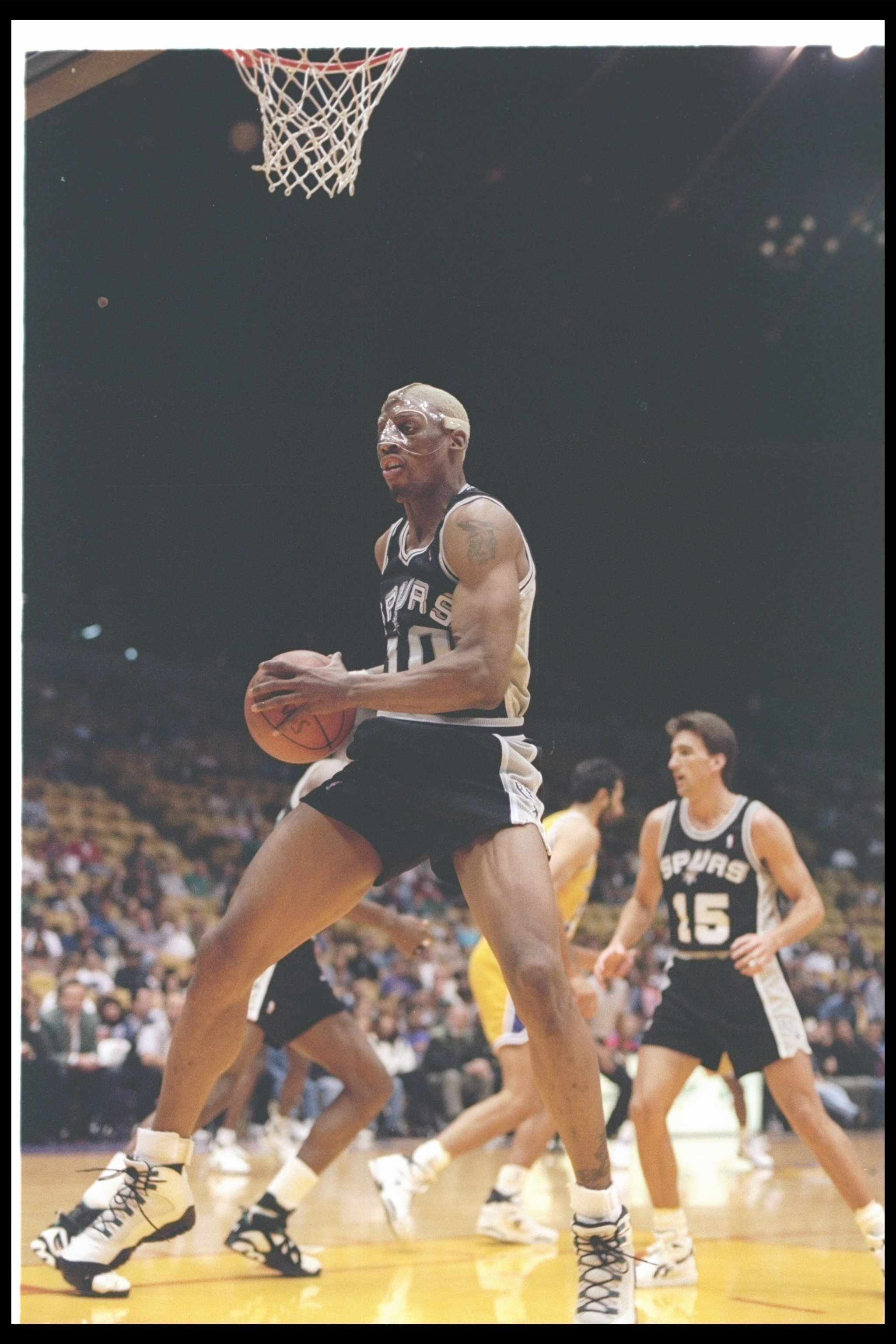 25 Mar 1994:  Forward Dennis Rodman of the San Antonio Spurs moves the ball during a game against the Los Angeles Lakers at the Great Western Forum in Inglewood, California. Mandatory Credit: J. D. Cuban  /Allsport Mandatory Credit: J. D. Cuban  /Allsport