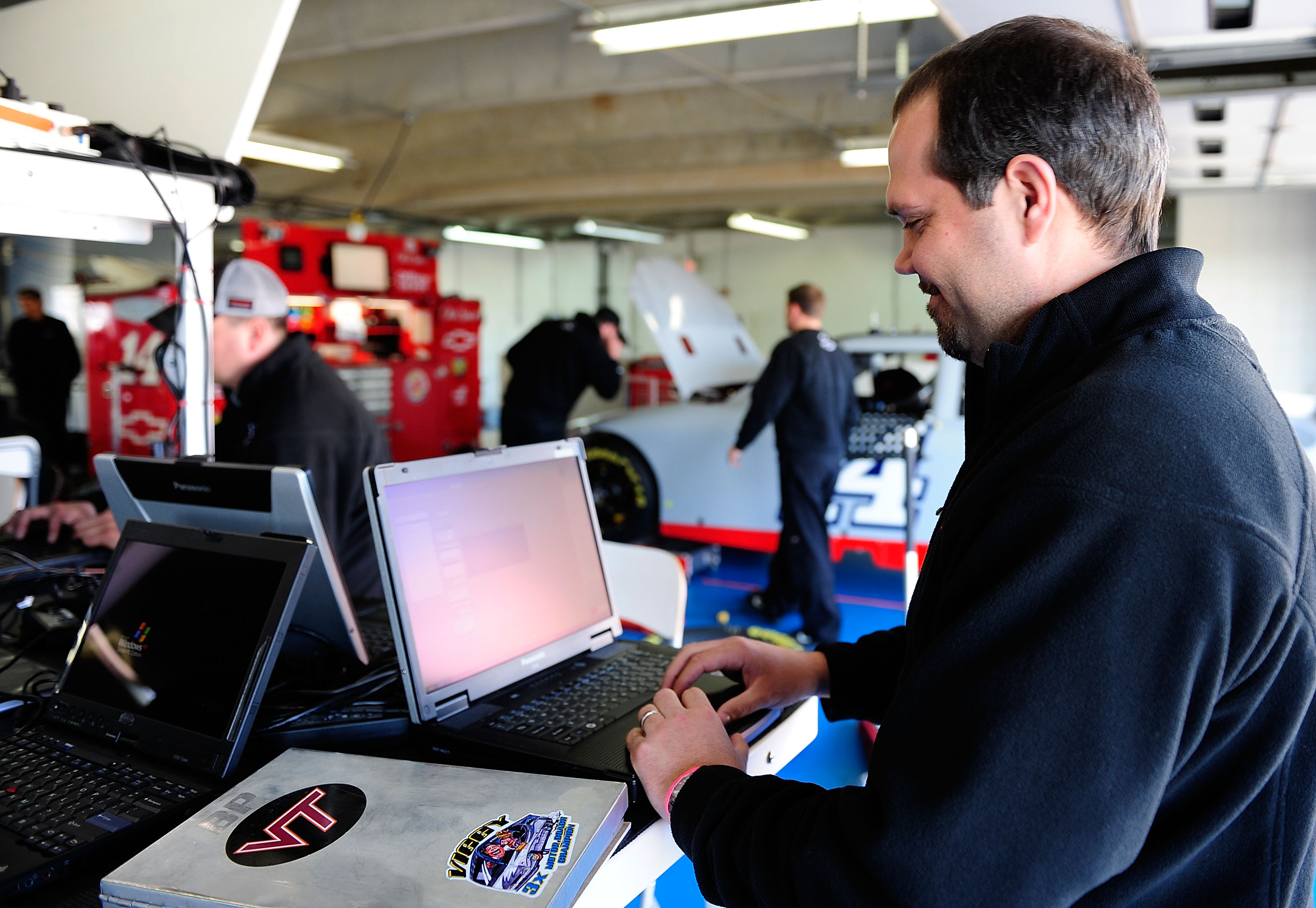 CONCORD, NC - MARCH 24:  Darian Grubb, crew chief for the #14 Steart Haas Chevrolet, enters data in a computer in the garage during NASCAR Sprint Cup Series testing at Charlotte Motor Speedway on March 24, 2010 in Concord, North Carolina.  (Photo by Rusty