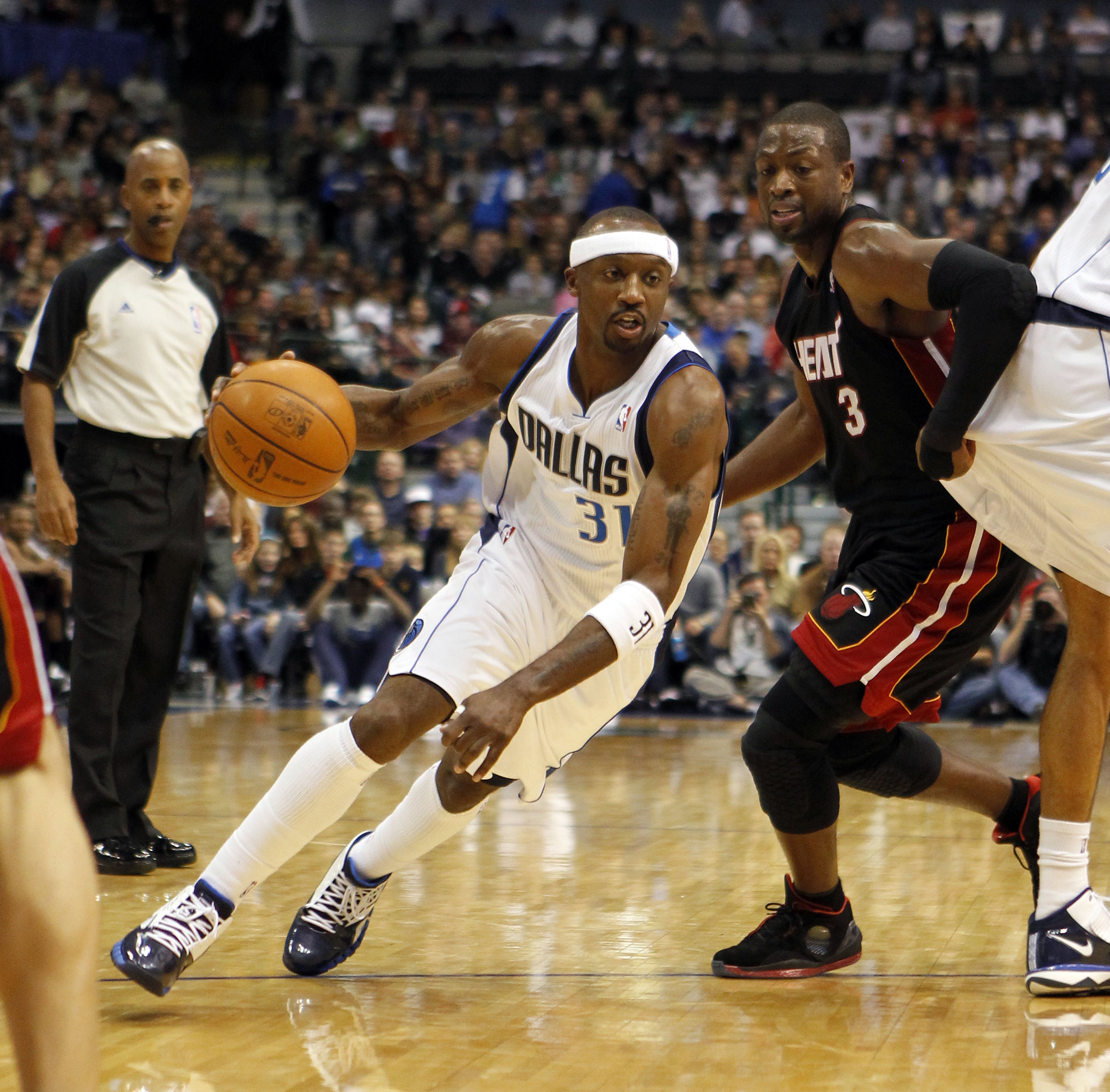 DALLAS - NOVEMBER 27: Jason Terry #31 of the Dallas Mavericks drives by Dwyane Wade #3 of the Miami Heat on November 27, 2010 at the American Airlines Center in Dallas, Texas. NOTE TO USER: User expressly acknowledges and agrees that, by downloading and o
