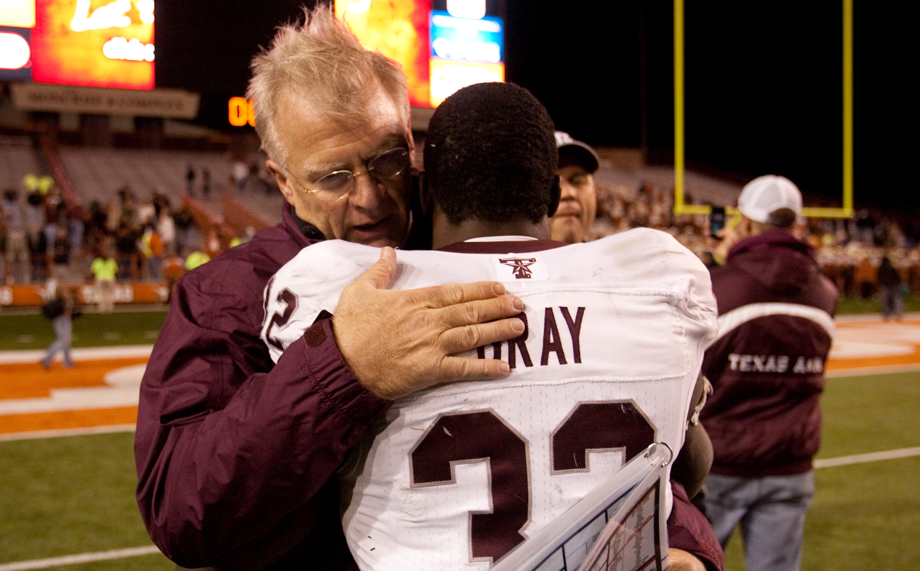 AUSTIN, TX - NOVEMBER 25:  Mike Sherman, head coach of Texas A&M, embraces running back Cyrus Gray #32 following Texas A&M's 24-17 win over The University of Texas at Darrell K. Royal-Texas Memorial Stadium on November 25, 2010 in Austin, Texas. (Photo by