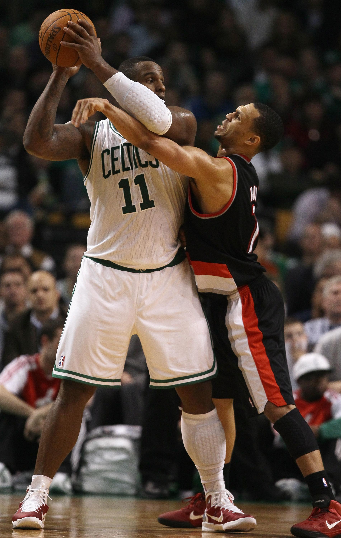 BOSTON - DECEMBER 01:  Glen Davis #11 of the Boston Celtics tries to keep the ball from Brandon Roy #7 of the Portland Trailblazers on December 1, 2010 at the TD Garden in Boston, Massachusetts. The Celtics defeated the Trailblazers 99-95. NOTE TO USER: U