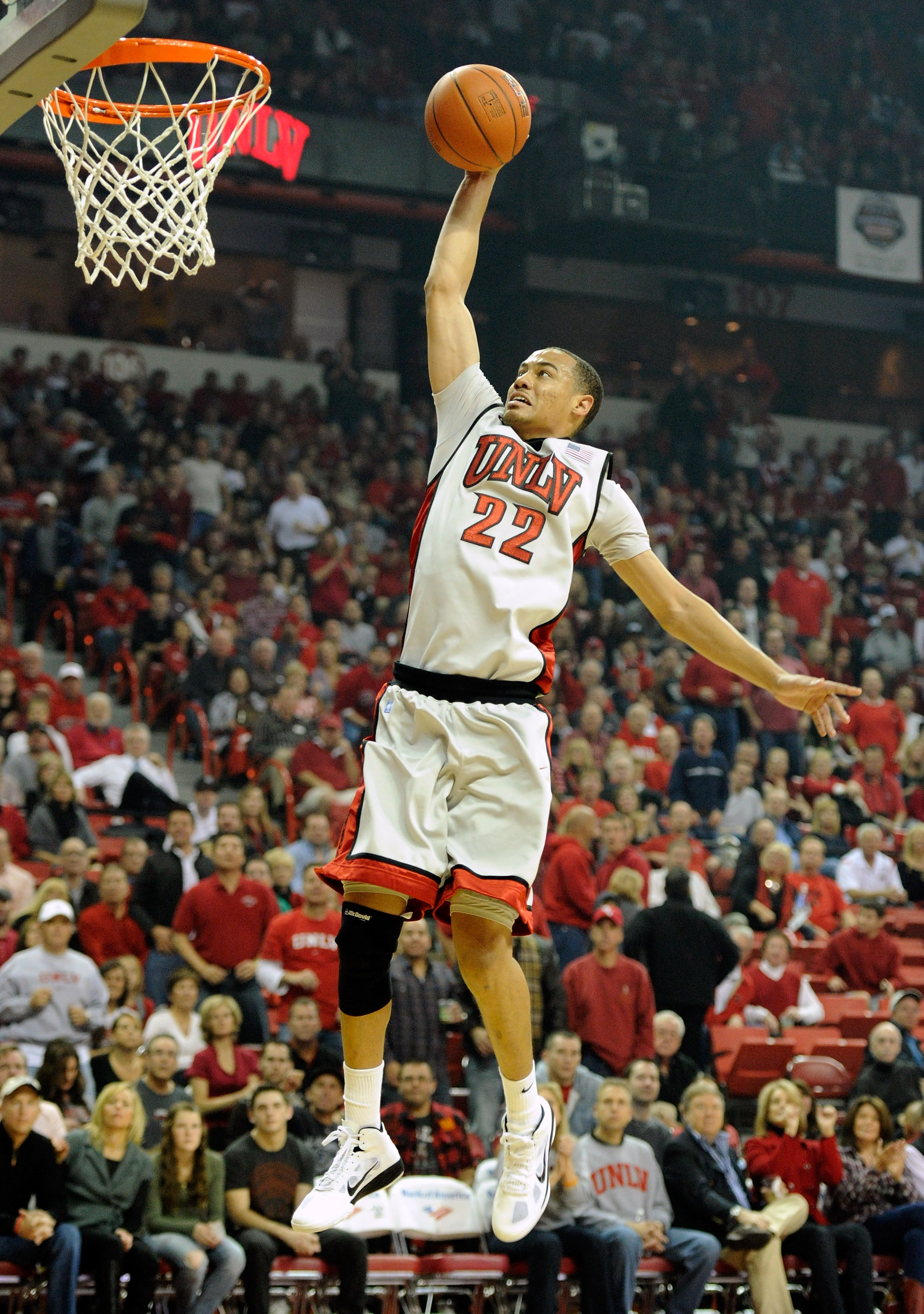 LAS VEGAS - NOVEMBER 20:  Chace Stanback #22 of the UNLV Rebels goes in for a dunk against the Wisconsin Badgers during their game at the Thomas & Mack Center November 20, 2010 in Las Vegas, Nevada. UNLV won 68-65.  (Photo by Ethan Miller/Getty Images)