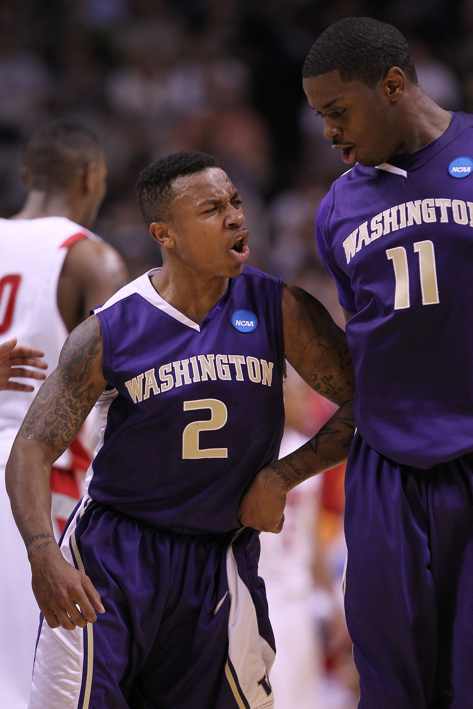 SAN JOSE, CA - MARCH 20:  Guard Isaiah Thomas #2 of the Washington Huskies celebrates with Matthew Bryan-Amaning #11 after a three point basket to give the Huskies a 10 point lead against the New Mexico Lobos in the second round of the 2010 NCAA men's bas