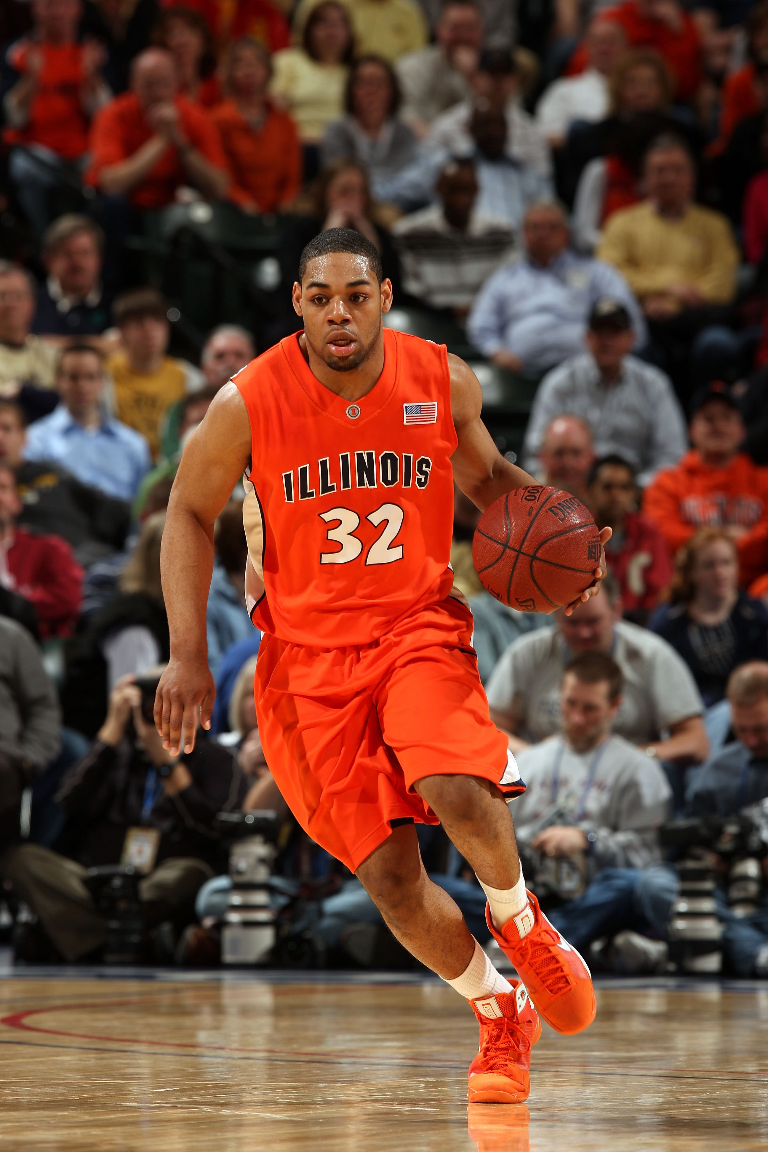 INDIANAPOLIS - MARCH 14:  Demetri McCamey #32 of the Illinois Fighting Illini brings the ball up court against the Purdue Boilermakers during their semifinal game of the Big Ten Men's Basketball Tournament at Conseco Fieldhouse on March 14, 2009 in Indian