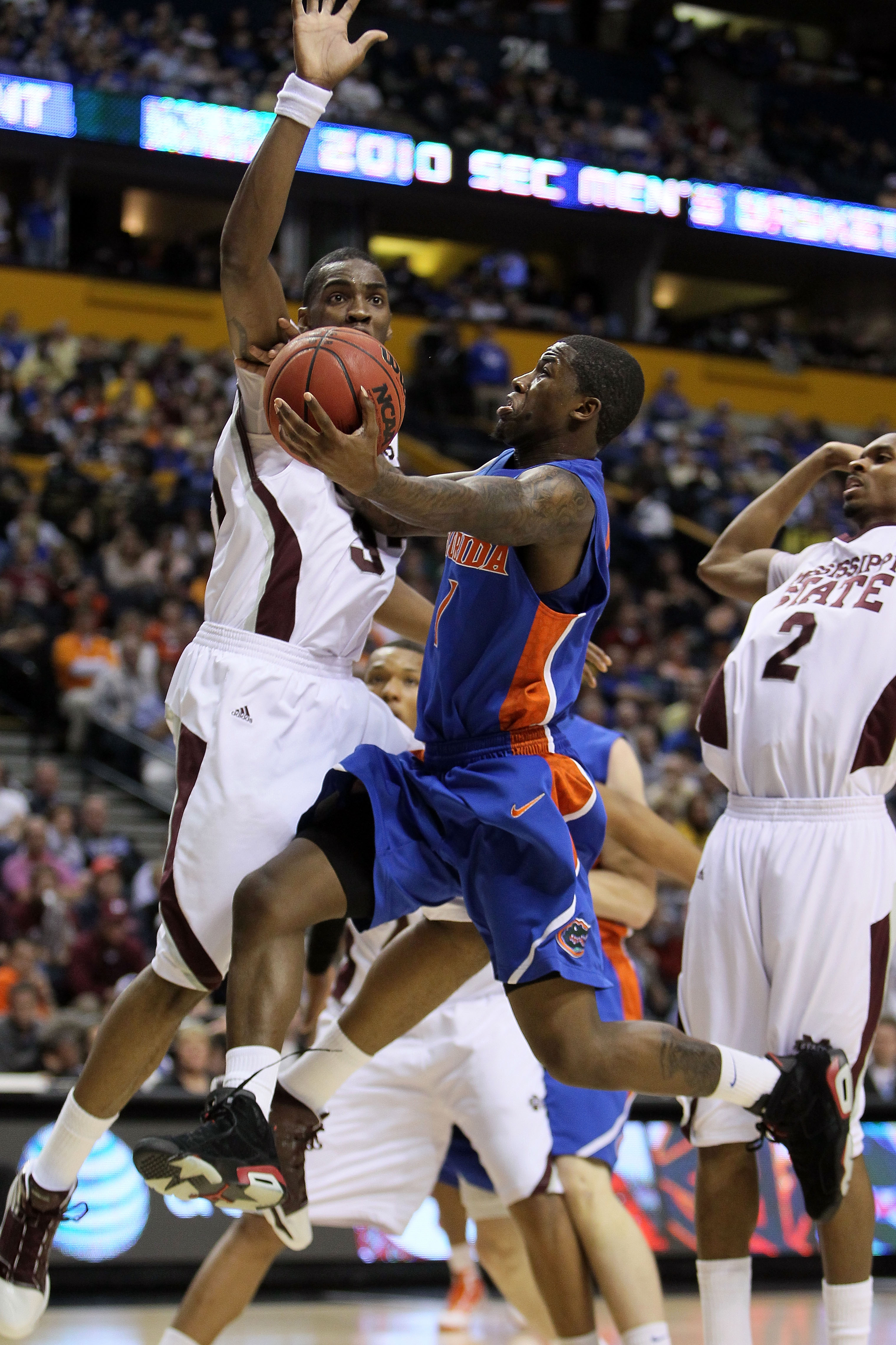 NASHVILLE, TN - MARCH 12:  Kenny Boynton #1 of the Florida Gators drives for a shot attempt against the Mississippi State Bulldogs during the quarterfinals of the SEC Men's Basketball Tournament at the Bridgestone Arena on March 12, 2010 in Nashville, Ten