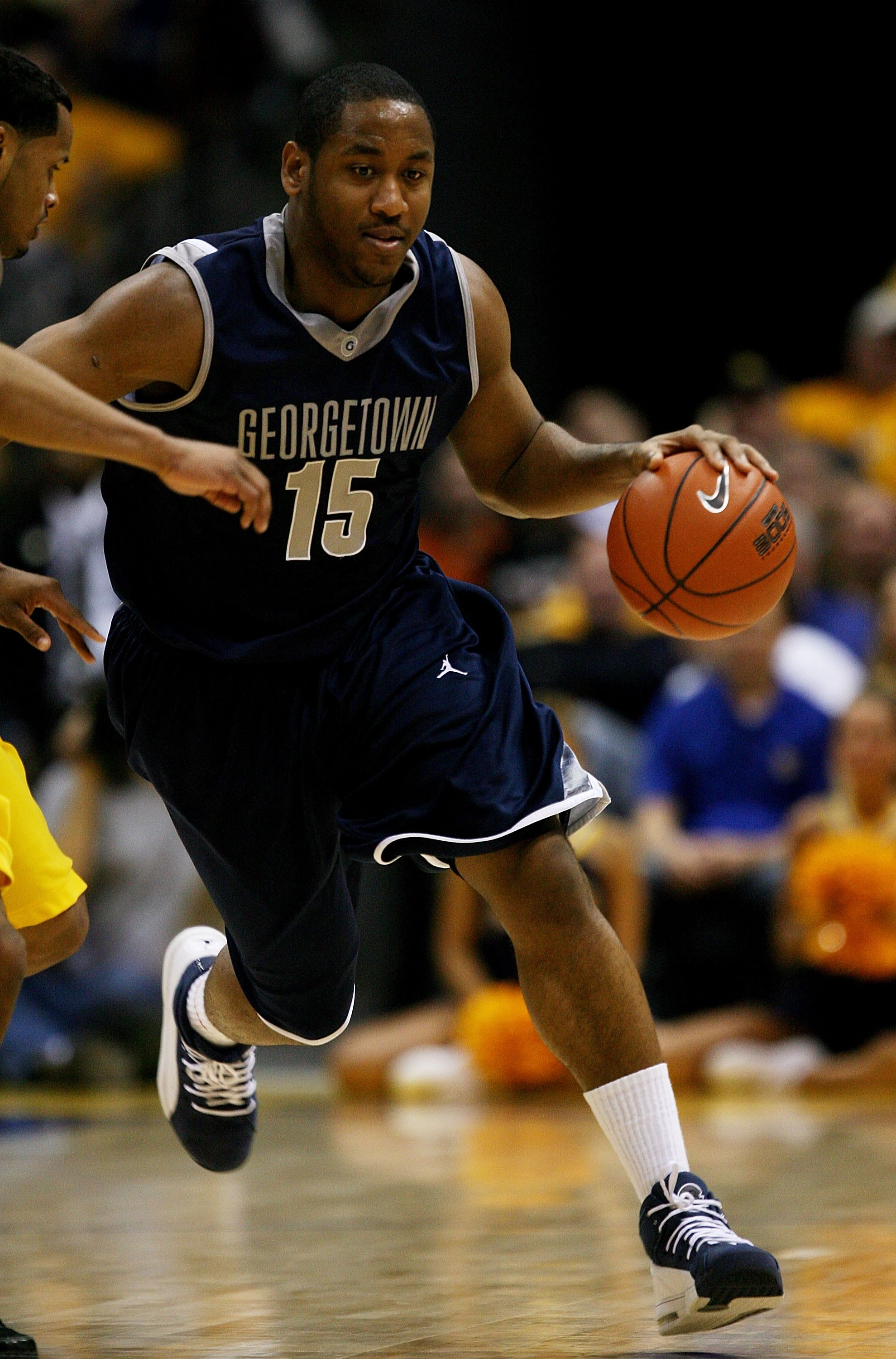 MILWAUKEE - JANUARY 31: Austin Freeman #15 of the Georgetown Hoyas brings the ball upcourt against the Marquette Golden Eagles on January 31, 2009 at the Bradley Center in Milwaukee, Wisconsin. Marquette defeated Georgetown 94-82. (Photo by Jonathan Danie