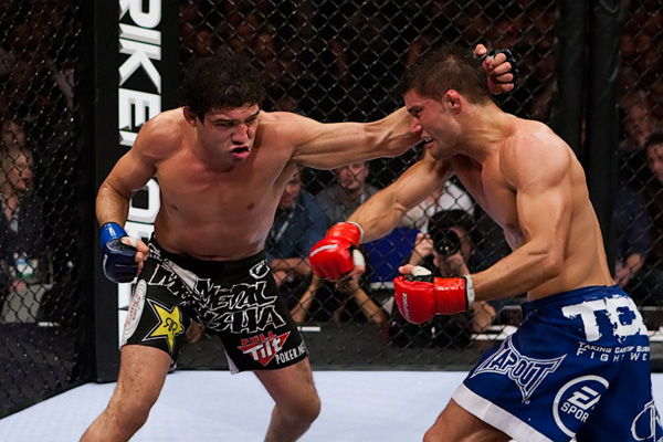 Gilbert Melendez (left) swings wildly with a left hook and misses.