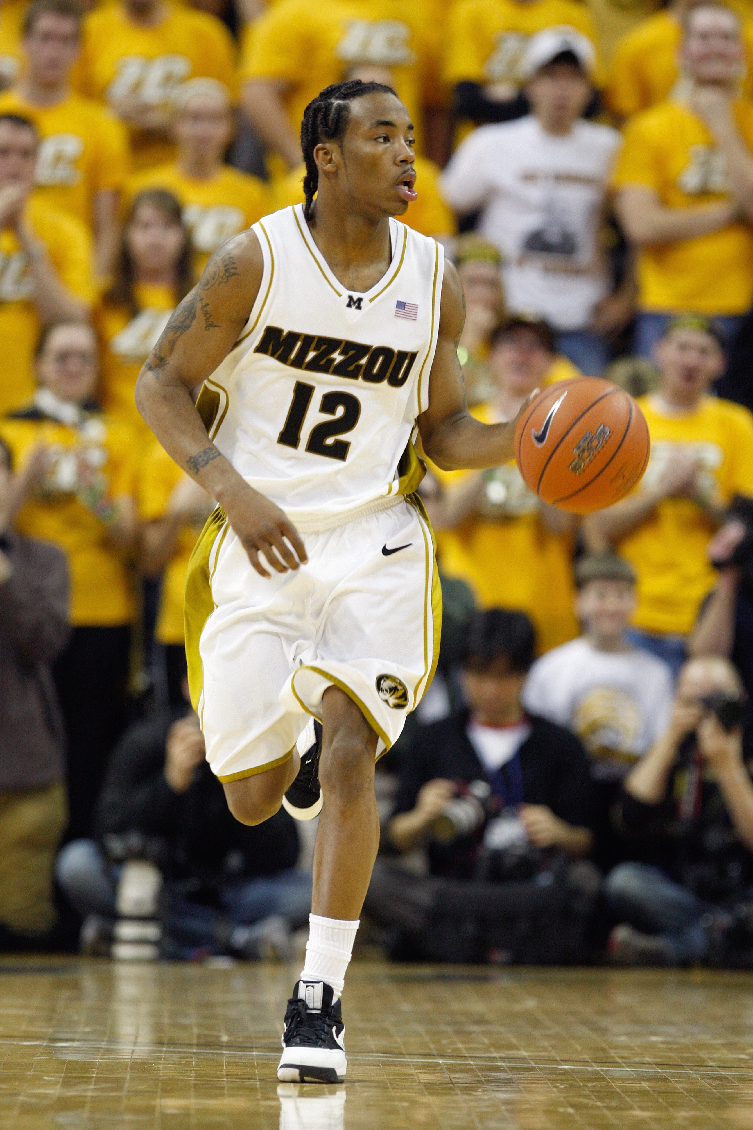 COLUMBIA, MISSOURI - FEBRUARY 9:  Marcus Denmon #12 of the Missouri Tigers dribbles the ball downcourt against the Kansas Jayhawks during the game on February 9, 2009 at Mizzou Arena in Columbia, Missouri. (Photo by: Jamie Squire/Getty Images)