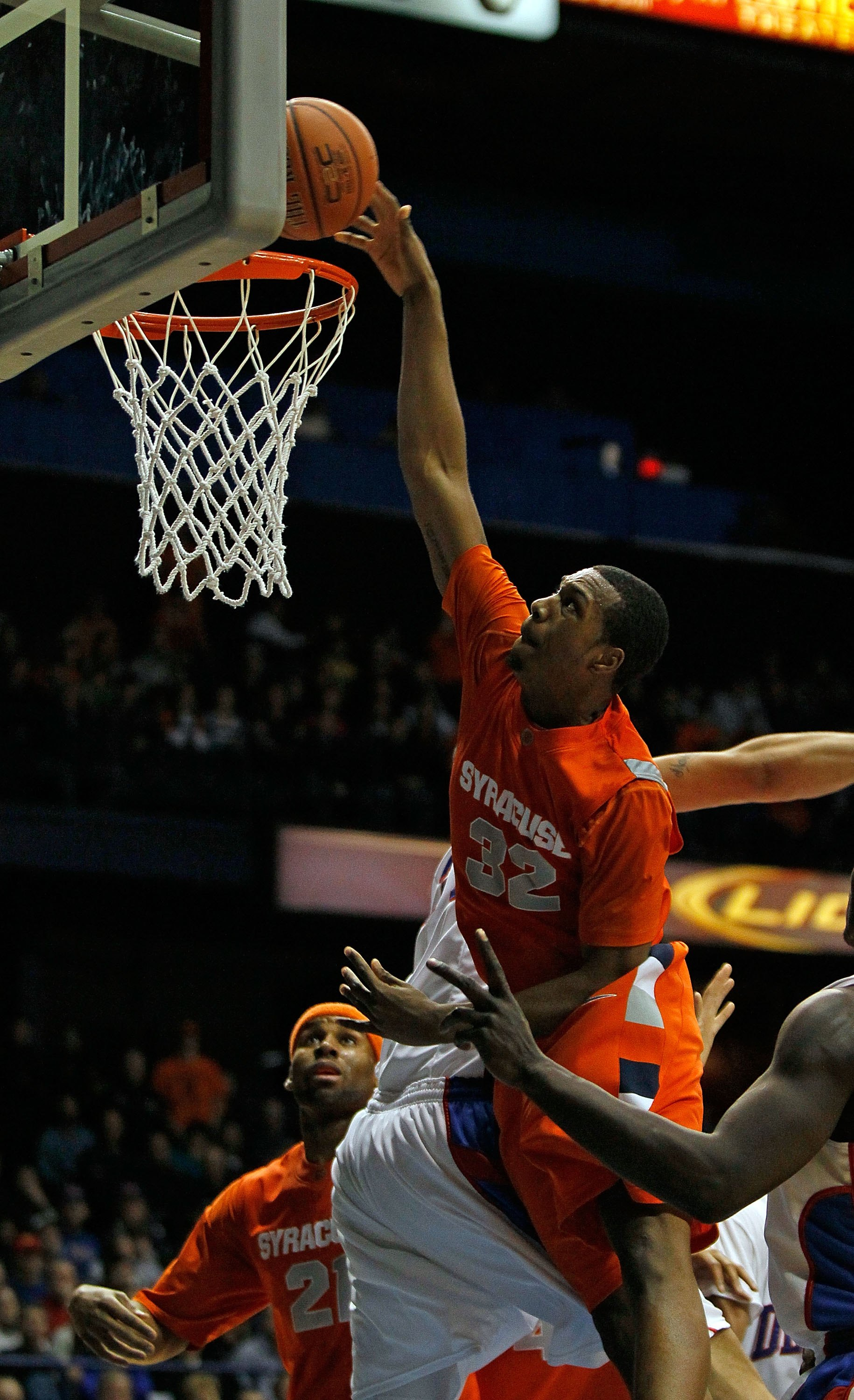 ROSEMONT, IL - JANUARY 30: Kris Joseph #32 of the Syracuse Orange puts up a shot over Kris Faber #33 of the DePaul Blue Demons at the Allstate Arena on January 30, 2010 in Rosemont, Illinois. Syracuse defeated DePaul 59-57. (Photo by Jonathan Daniel/Getty