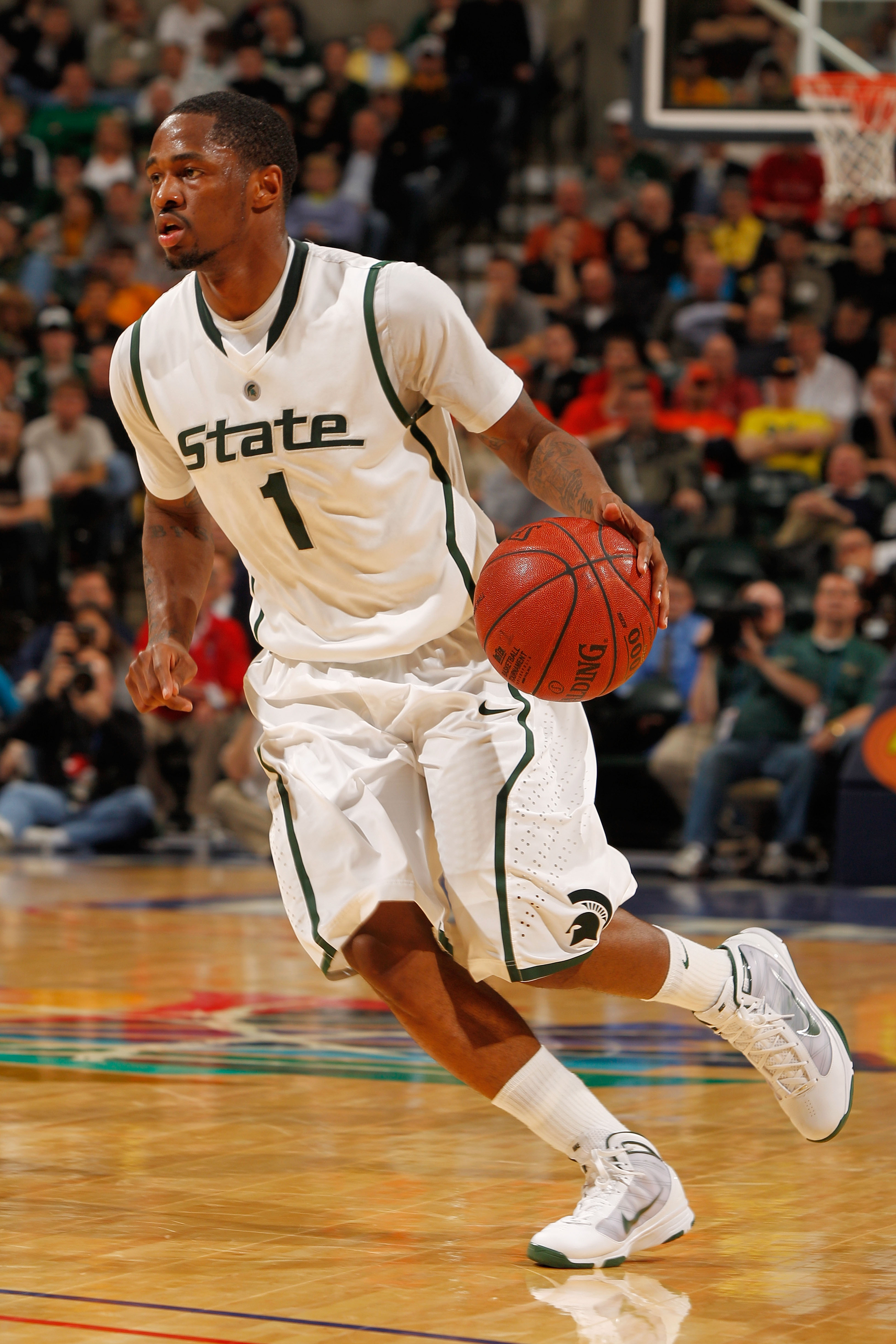 INDIANAPOLIS - MARCH 12:  Kalin Lucas #1 of the Michigan State Spartans moves the ball against the Minnesota Golden Gophers during the quarterfinals of the Big Ten Men's Basketball Tournament at Conseco Fieldhouse on March 12, 2010 in Indianapolis, Indian