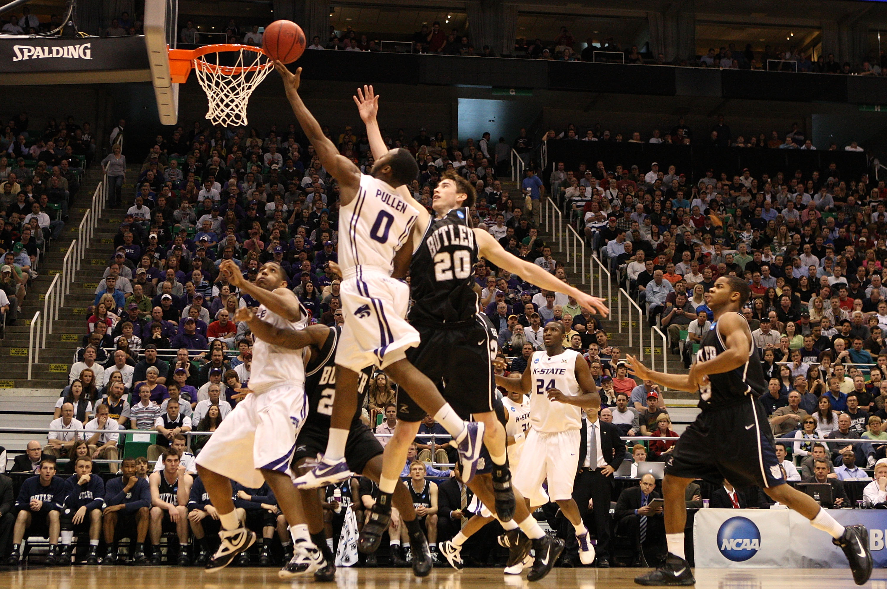 SALT LAKE CITY - MARCH 27:  Gordon Hayward #20 of the Butler Bulldogs defends against Jacob Pullen #0 of the Kansas State Wildcats during the west regional final of the 2010 NCAA men's basketball tournament at the Energy Solutions Arena on March 27, 2010