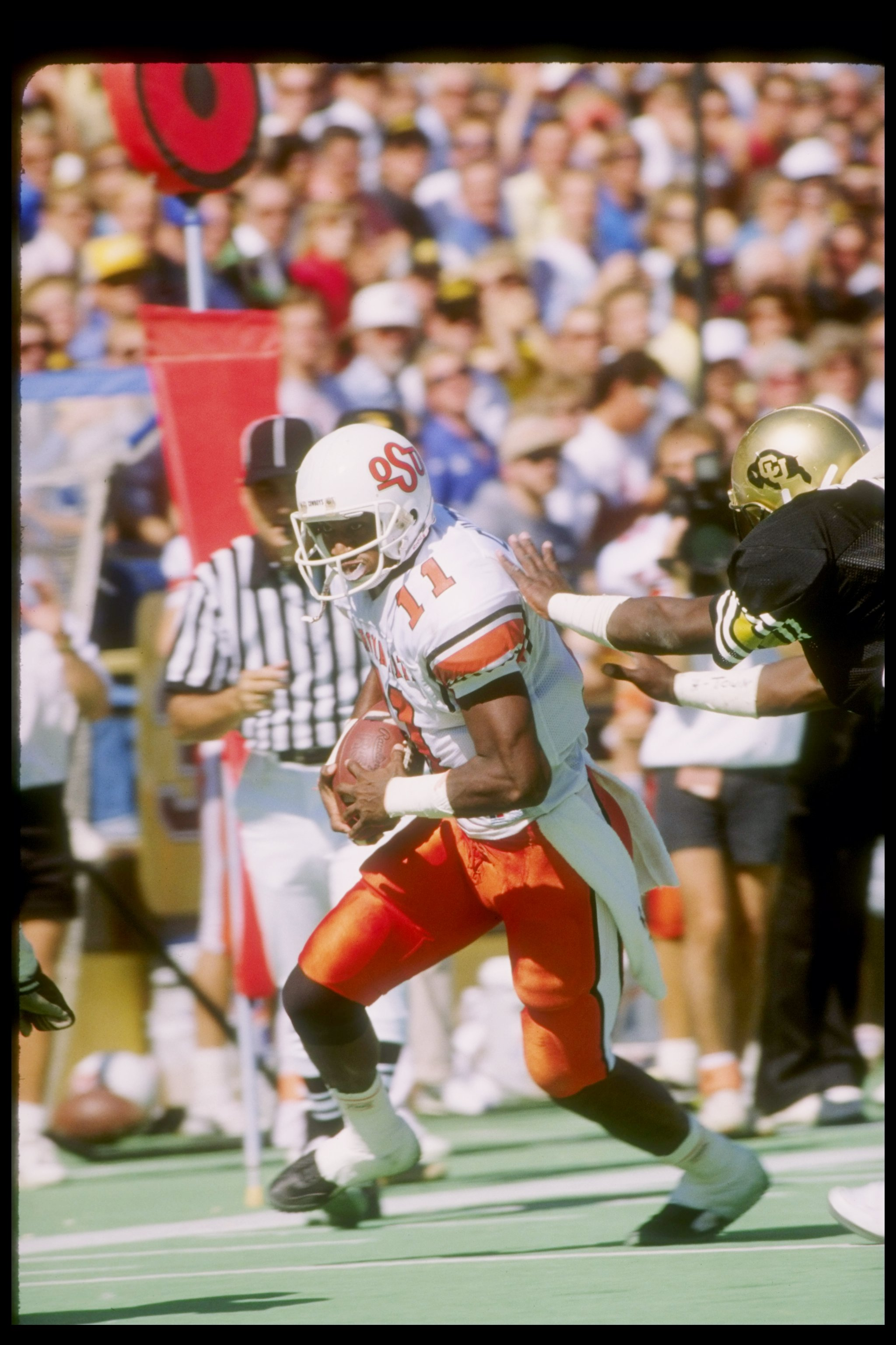 Oct 1988:  Quarterback Hart Lee Dykes of the Oklahoma State Cowboys runs to the end zone during a game versus the Colorado Buffaloes at Folsom Field in Boulder, Colorado. Mandatory Credit: Allsport  /Allsport