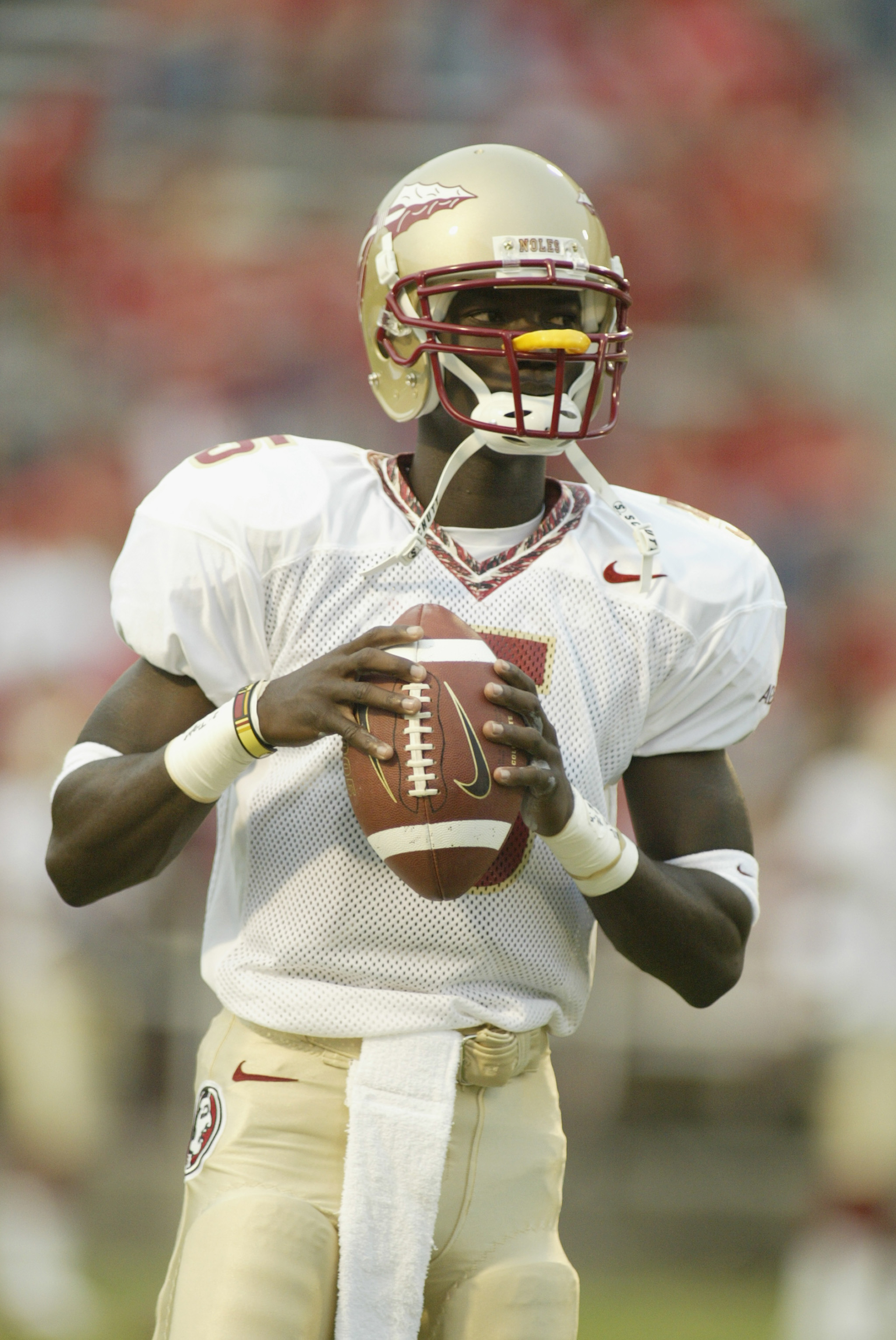 COLLEGE PARK, MARYLAND - SEPTEMBER  14:  Adrian McPherson #5 of the Florida State University Seminoles holds the ball in warmups before the game against the University of Maryland Terrapins on September 14, 2002 at Byrd Stadium in College Park, Maryland.