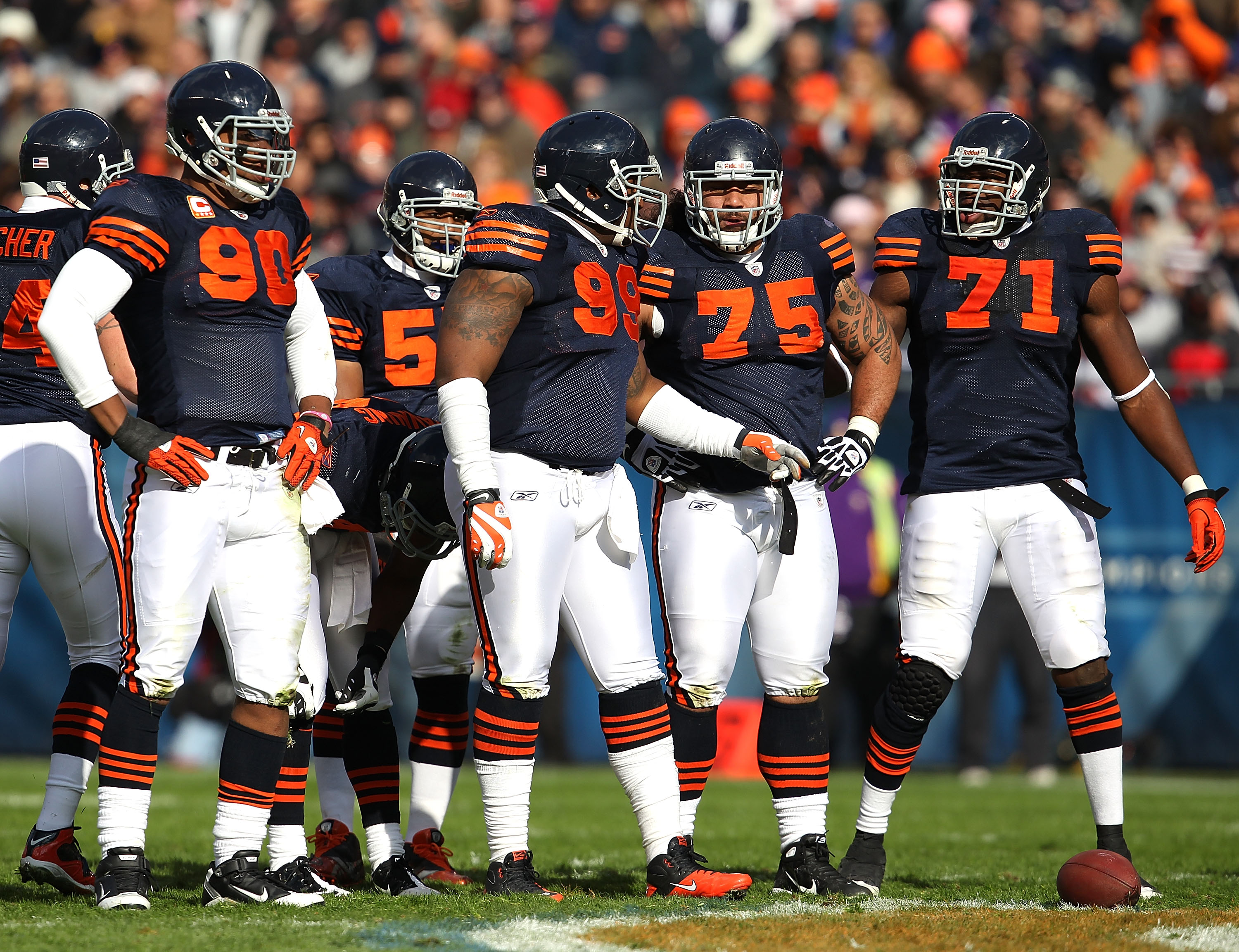 CHICAGO - NOVEMBER 14: Members of the Chicago Bear defense including (L-R) Julius Peppers #90, Lance Briggs #55, Marcus Harrison #99, Matt Toeaina #75 and Israel Idonije #71 await the start of play against the Minnesota Vikings at Soldier Field on Novembe