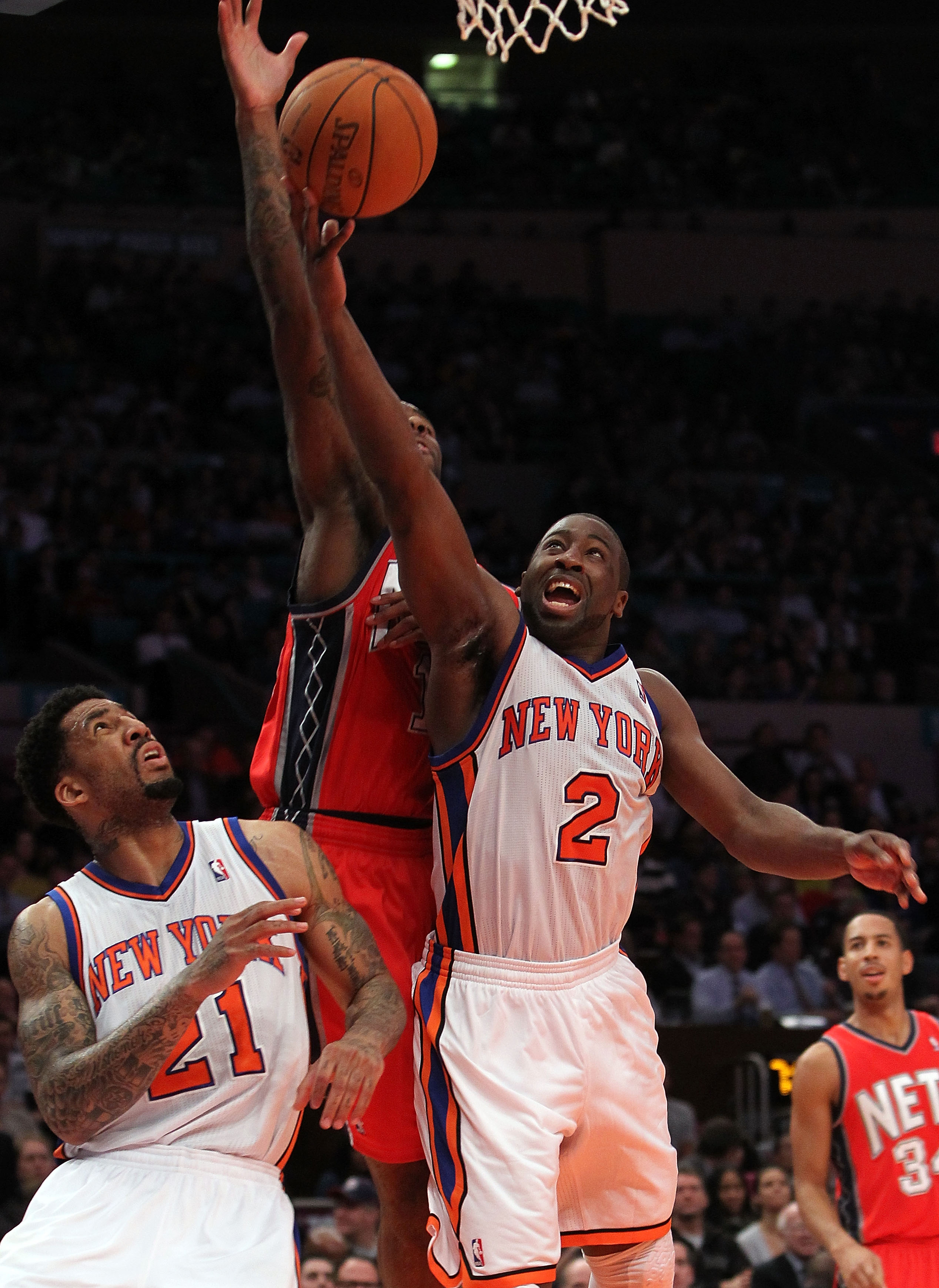 NEW YORK, NY - NOVEMBER 30:  Raymond Felton #2 of the New York Knicks lays the ball up agaisnt the New Jersey Nets on November 30, 2010 at Madison Square Garden in New York City. NOTE TO USER: User expressly acknowledges and agrees that, by downloading an