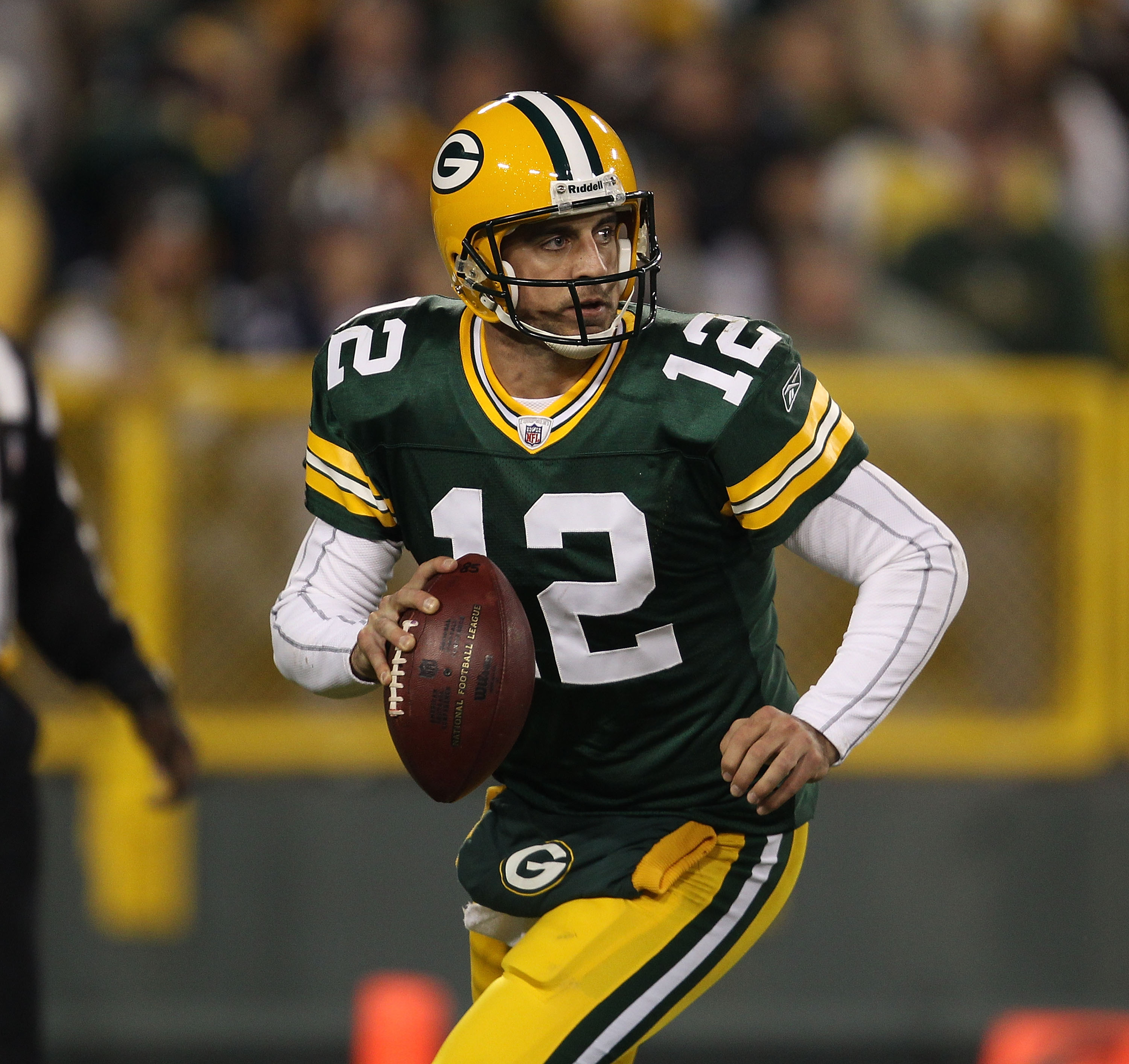 GREEN BAY, WI - NOVEMBER 07: Aaron Rodgers #12 of the Green Bay Packers looks for a receiver against the Dallas Cowboys at Lambeau Field on November 7, 2010 in Green Bay, Wisconsin. The Packers defeated the Cowboys 45-7. (Photo by Jonathan Daniel/Getty Im