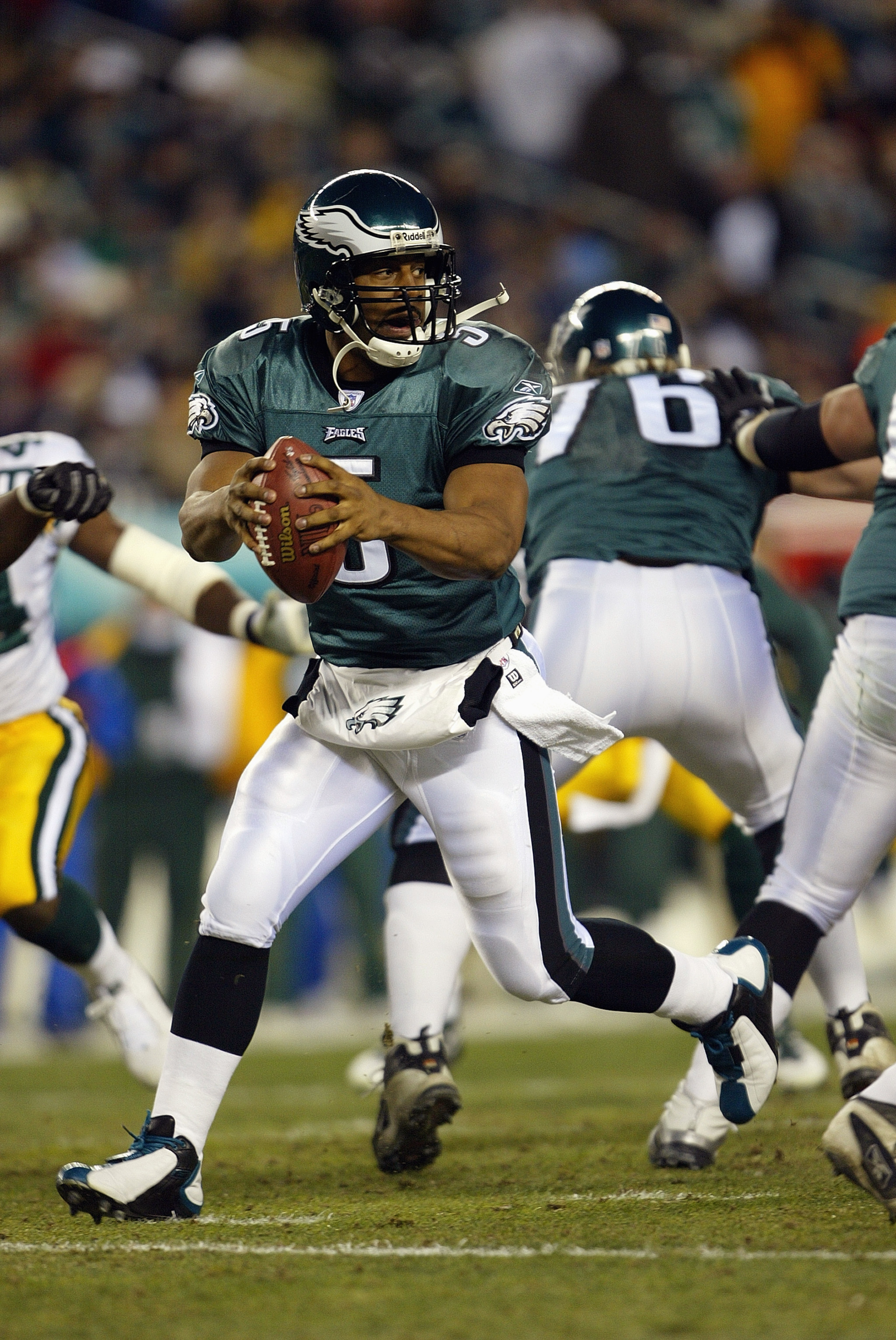 PHILADELPHIA - JANUARY 11:  Quarterback Donovan McNabb #5 of the Philadelphia Eagles drops back to pass during the game against the Green Bay Packers in the NFC divisional playoffs on January 11, 2004 at Lincoln Financial Field in Philadelphia, Pennsylvan