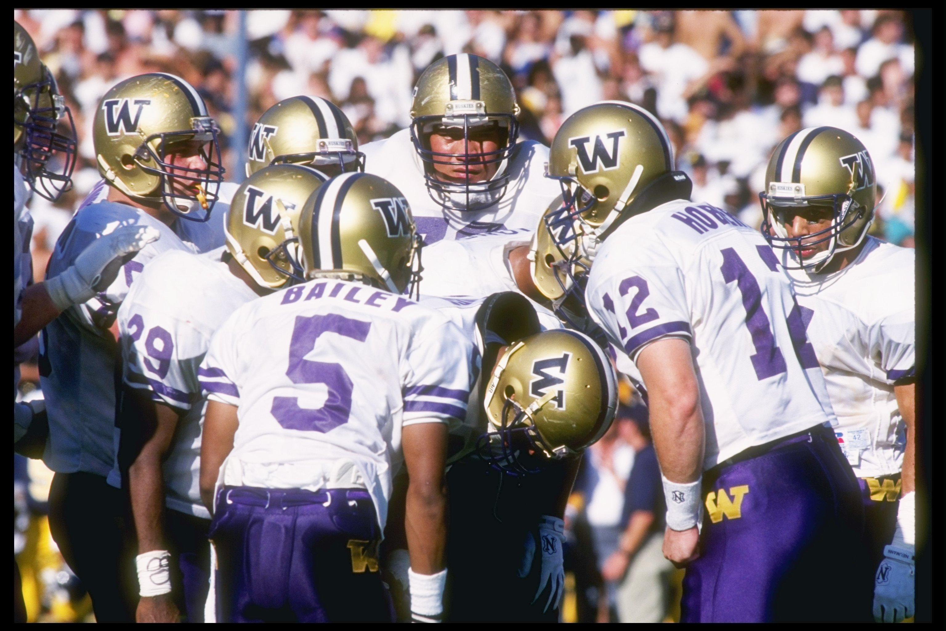19 Oct 1991:  University of Washington Huskies quarterback Billy Joe Hobert calls out the play in the huddle during game against the University of California Golden Bears at Memorial Stadium in Berkeley, California.  The University of Washington won the g