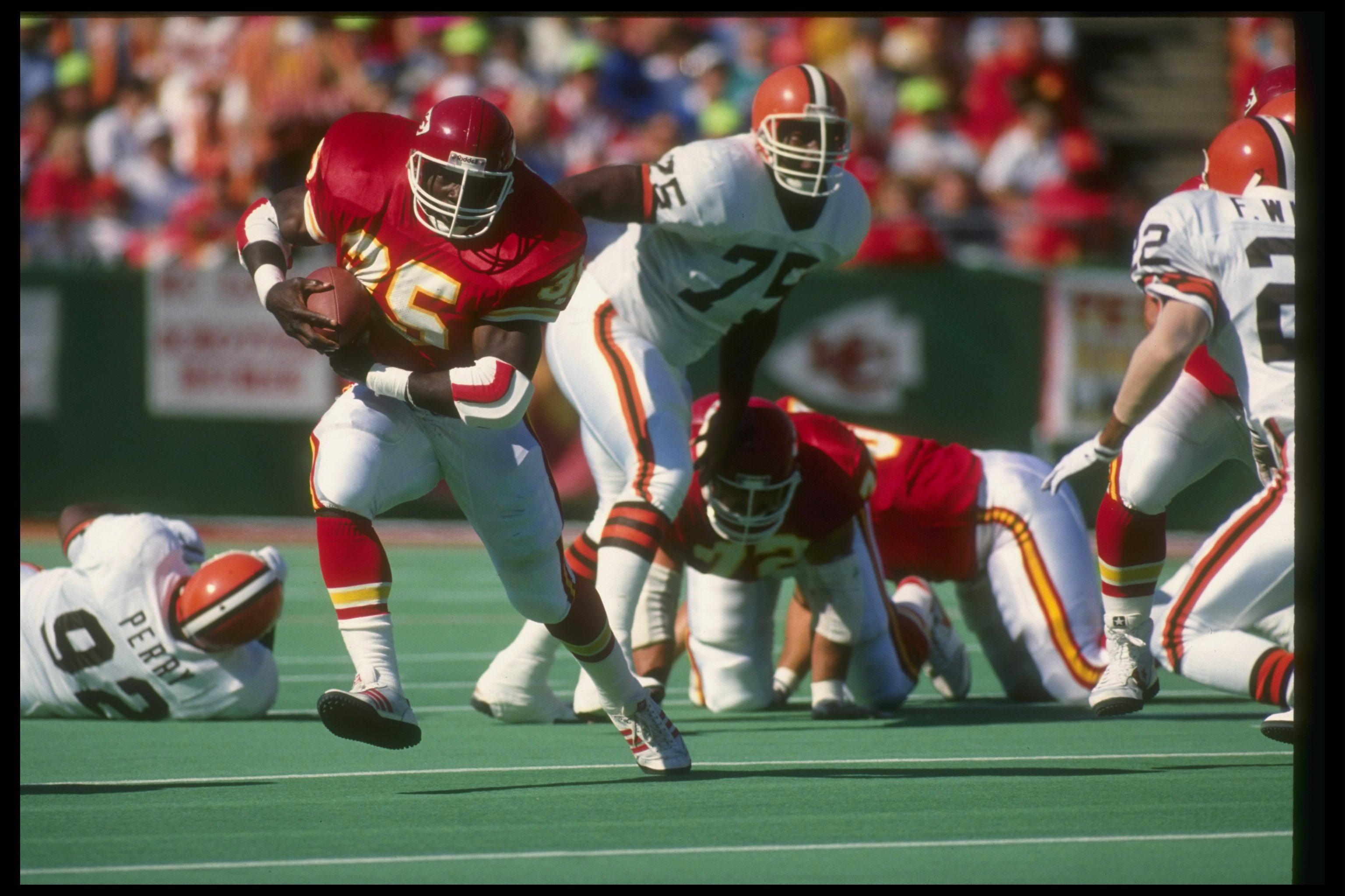 30 Sep 1990: Running back Christian Okoye of the Kansas City Chiefs (left) moves the ball during a game against the Cleveland Browns at Arrowhead Stadium in Kansas City, Missouri. The Chiefs won the game, 34-0.