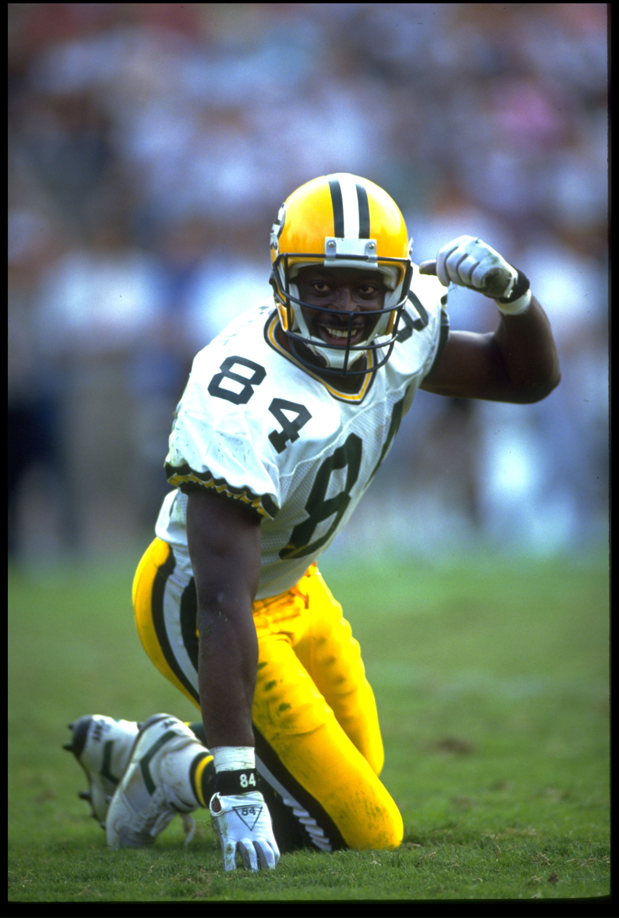 11 NOV 1990:  GREEN PACKERS WIDE RECEIVER STERLING SHARPE LOOKS BACK TO THE LINE OF SCRIMMAGE DURING THE PACKERS 29-16 VICTORY OVER THE LOS ANGELES RAIDERS AT THE LOS ANGELES MEMORIAL COLISEUM IN LOS ANGELES, CALIFORNIA.