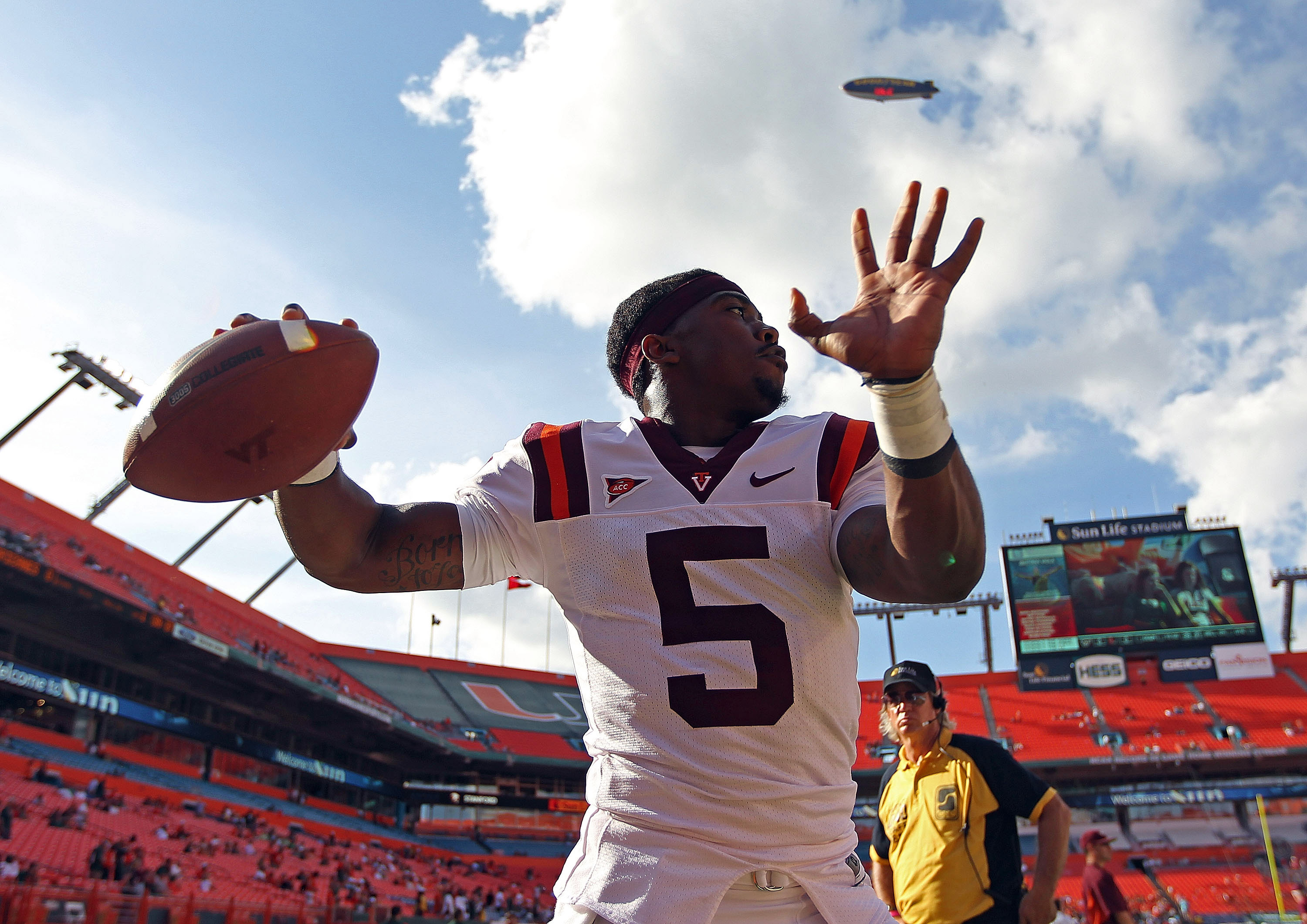 MIAMI - NOVEMBER 20:  Tyrod Taylor #5 of the Virginia Tech Hokies warms up during a game against the Miami Hurricanes at Sun Life Stadium on November 20, 2010 in Miami, Florida.  (Photo by Mike Ehrmann/Getty Images)