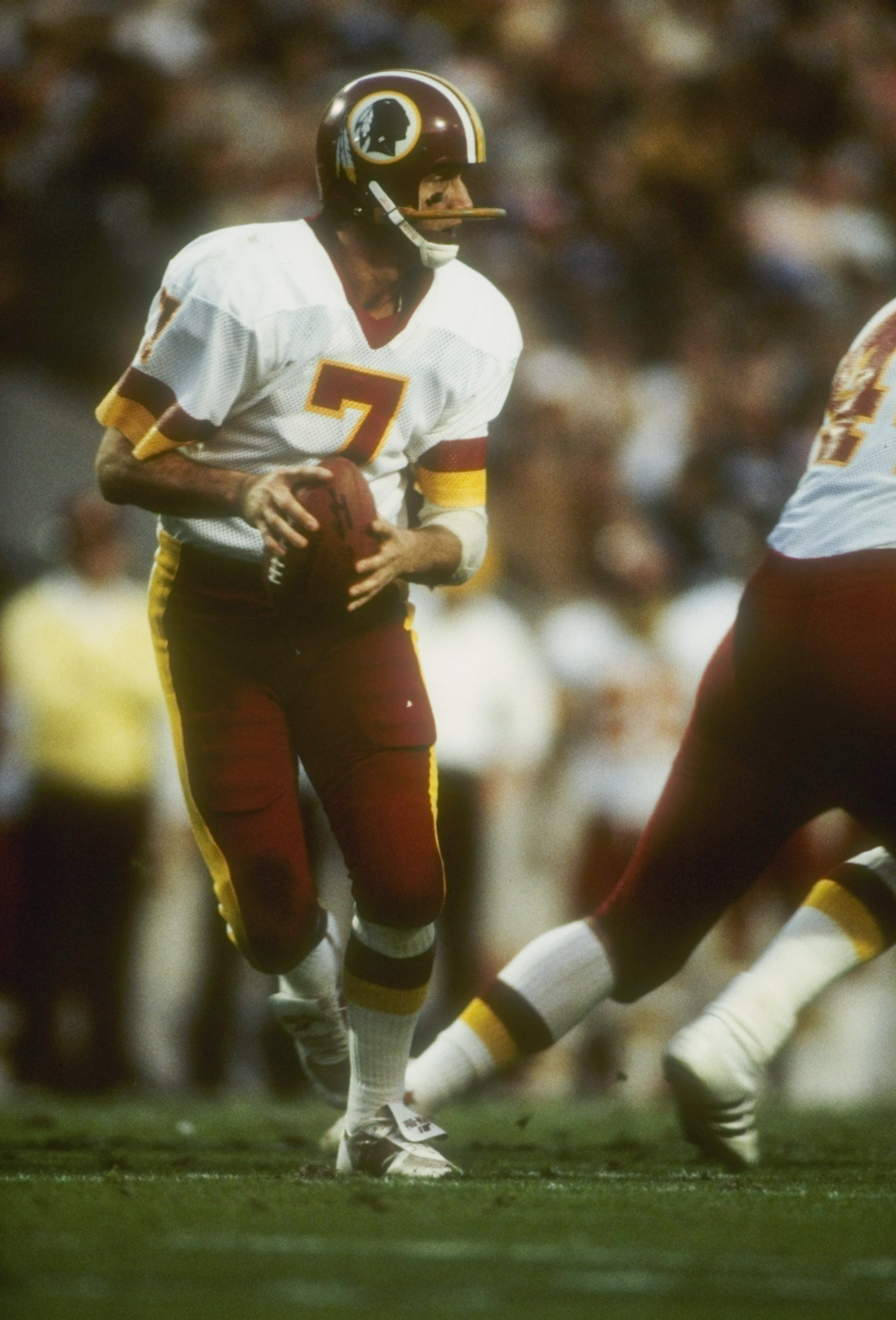 22  Jan 1984:   Quarterback Joe Theismann #7 of the Washington Redskins looks to pass during Super Bowl XVIII against the Los Angeles Raiders at Tampa Stadium in Tampa, Florida. The Raiders won the game 38-9. Mandatory Credit: Allsport  /Allsport
