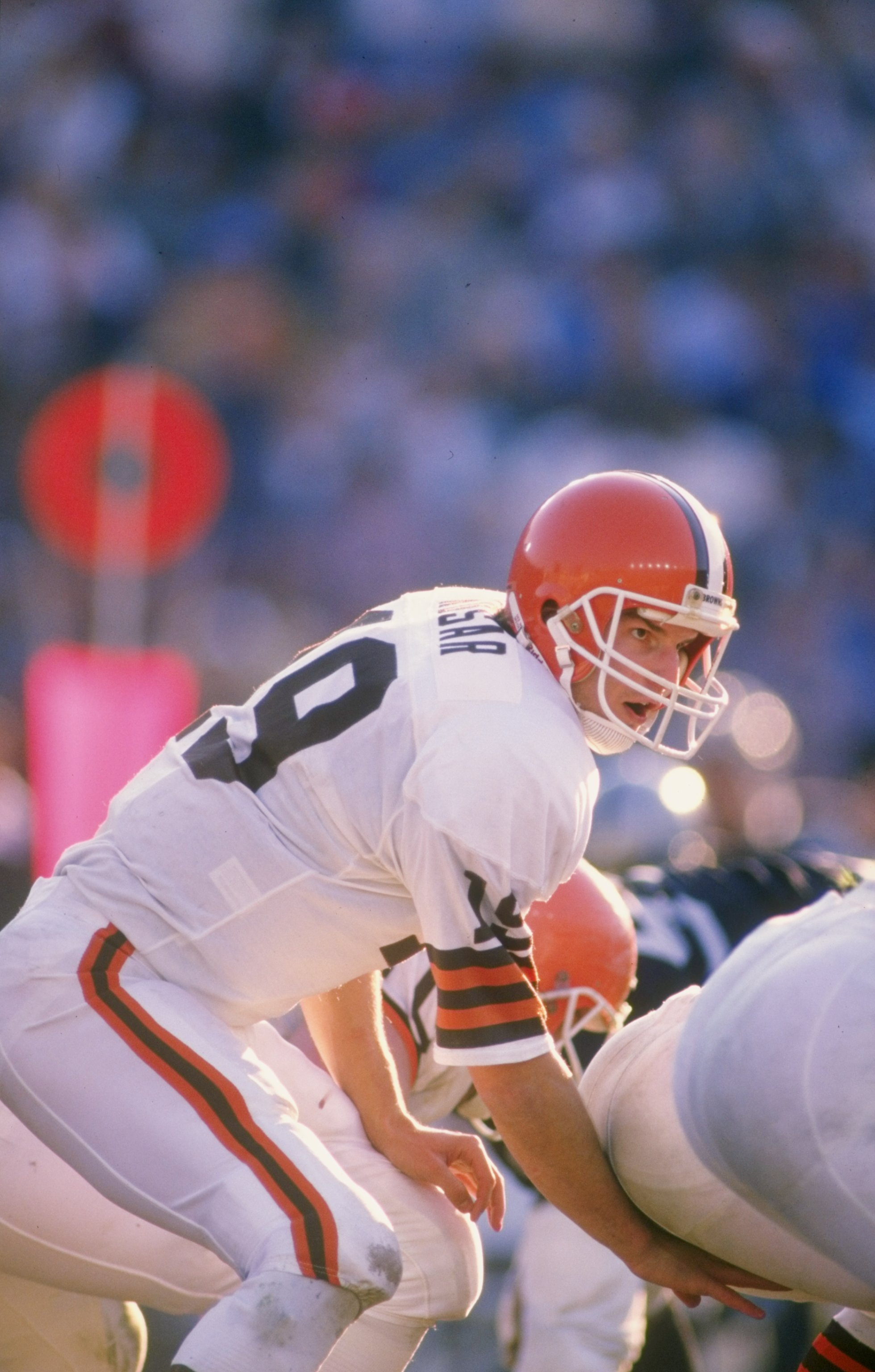 Quarterback Bernie Kosar of the Cleveland Browns calls signals at the line during a game against the Los Angeles Raiders at the Los Angeles Memorial Coliseum in Los Angeles, California. The Browns won the game 24-17.