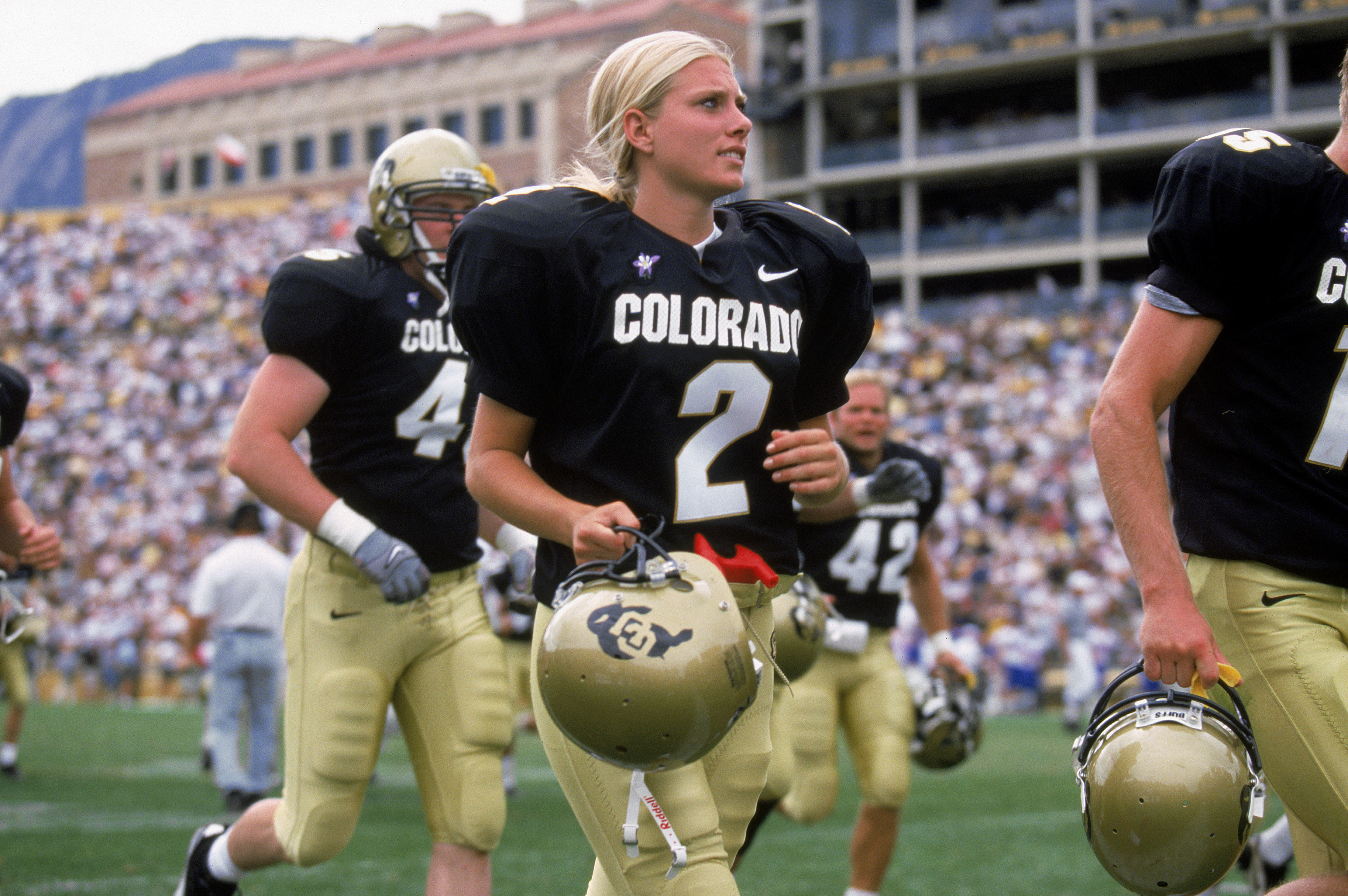 BOULDER, CO - SEPTEMBER 18:  Katie Hnida of the University of Colorado heads off the field during the game against the University of Kansas at Folsom Field on September 18, 1999 in Boulder, Colorado. The University of Colorado won 51-17. (Photo by  Brian
