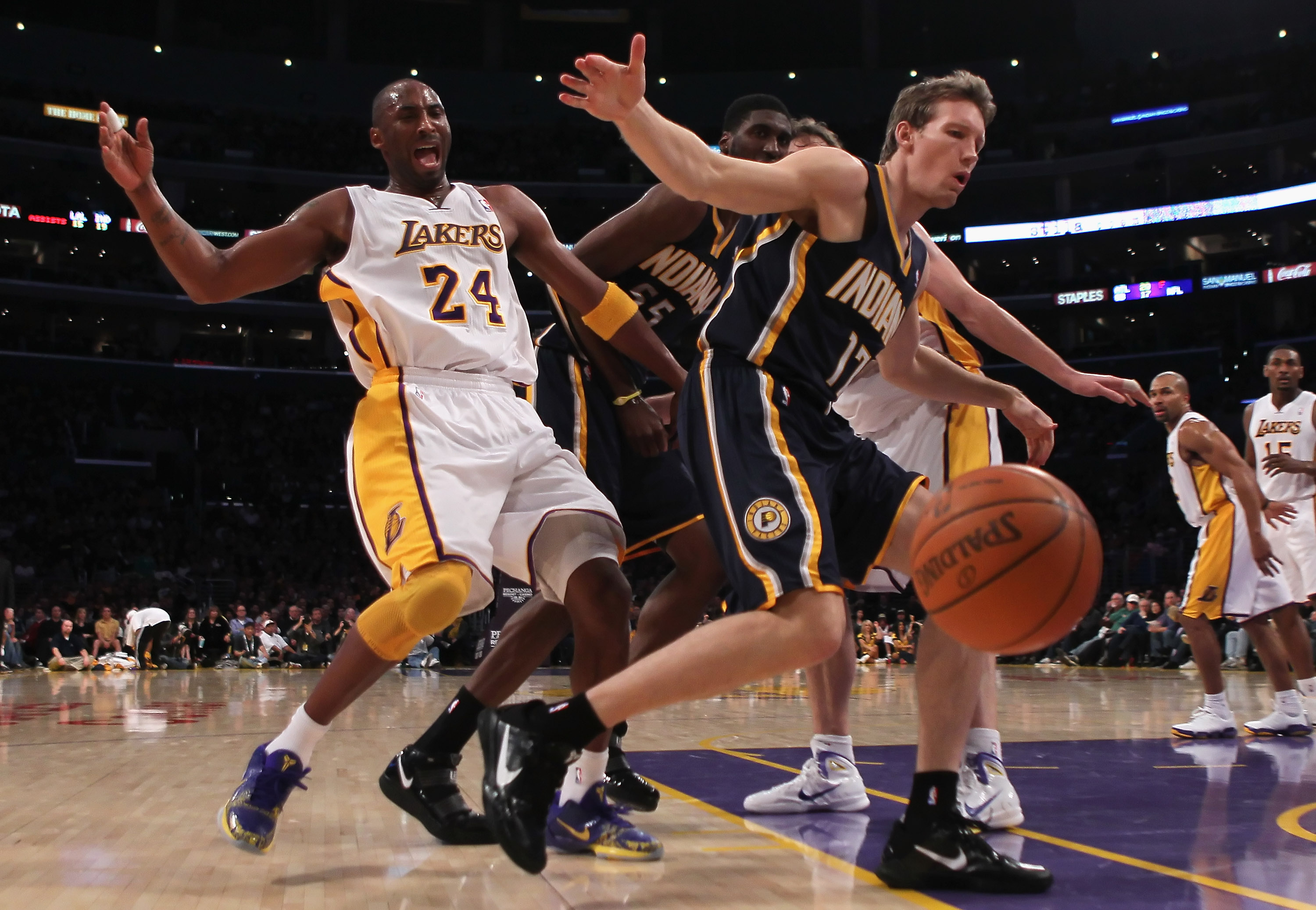 LOS ANGELES, CA - NOVEMBER 28:  Kobe Bryant #24 of the Los Angeles Lakers is fouled by Mike Dunleavy #17 of the Indiana Pacers during the third quarter at Staples Center on November 28, 2010 in Los Angeles, California. The Pacers defeated the Lakers 95-92