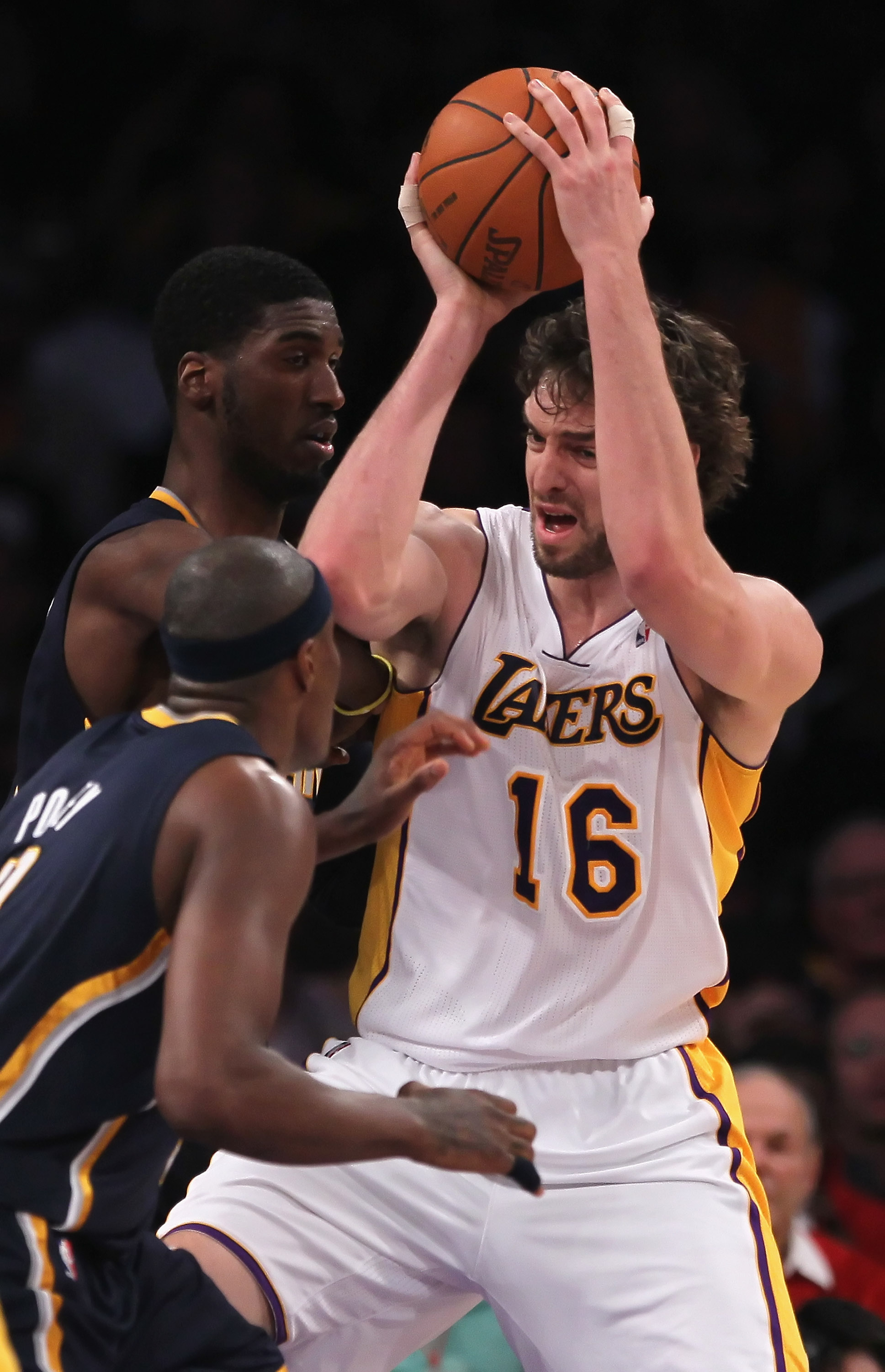 LOS ANGELES, CA - NOVEMBER 28:  Pau Gasol #16 of the Los Angeles Lakers is guarded by Roy Hibbert #55 and  T.J. Ford #5 of the Indiana Pacers during the second quarter at Staples Center on November 28, 2010 in Los Angeles, California. NOTE TO USER: User e