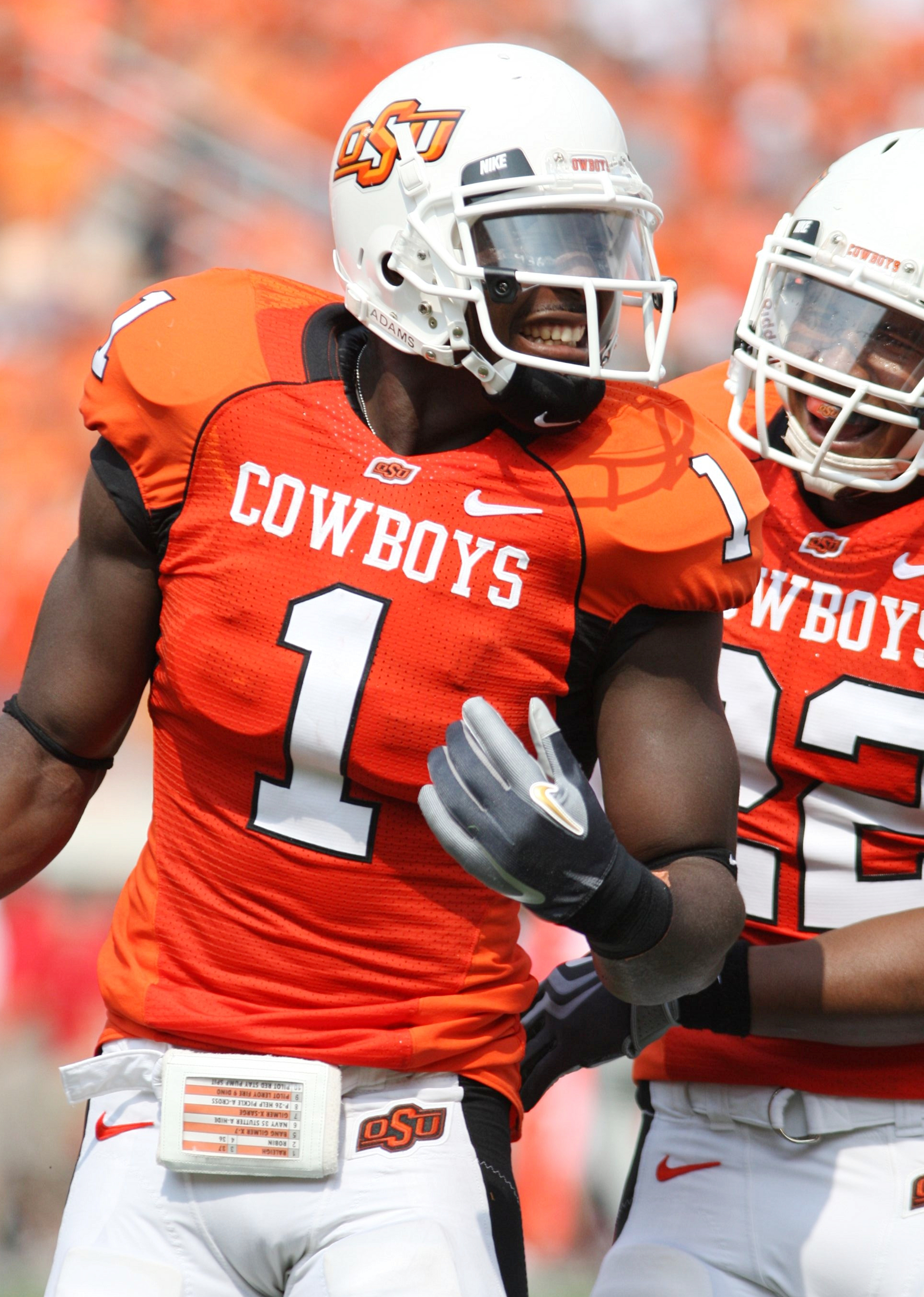 STILLWATER, OK - SEPTEMBER 5:  Wide receiver Dez Bryant #1 of the Oklahoma State Cowboys celebrates his touchdown with teammate Dexter Pratt #22 during the second quarter of the game against the Georgia Bulldogs at Boone Pickens Stadium on September 5, 20