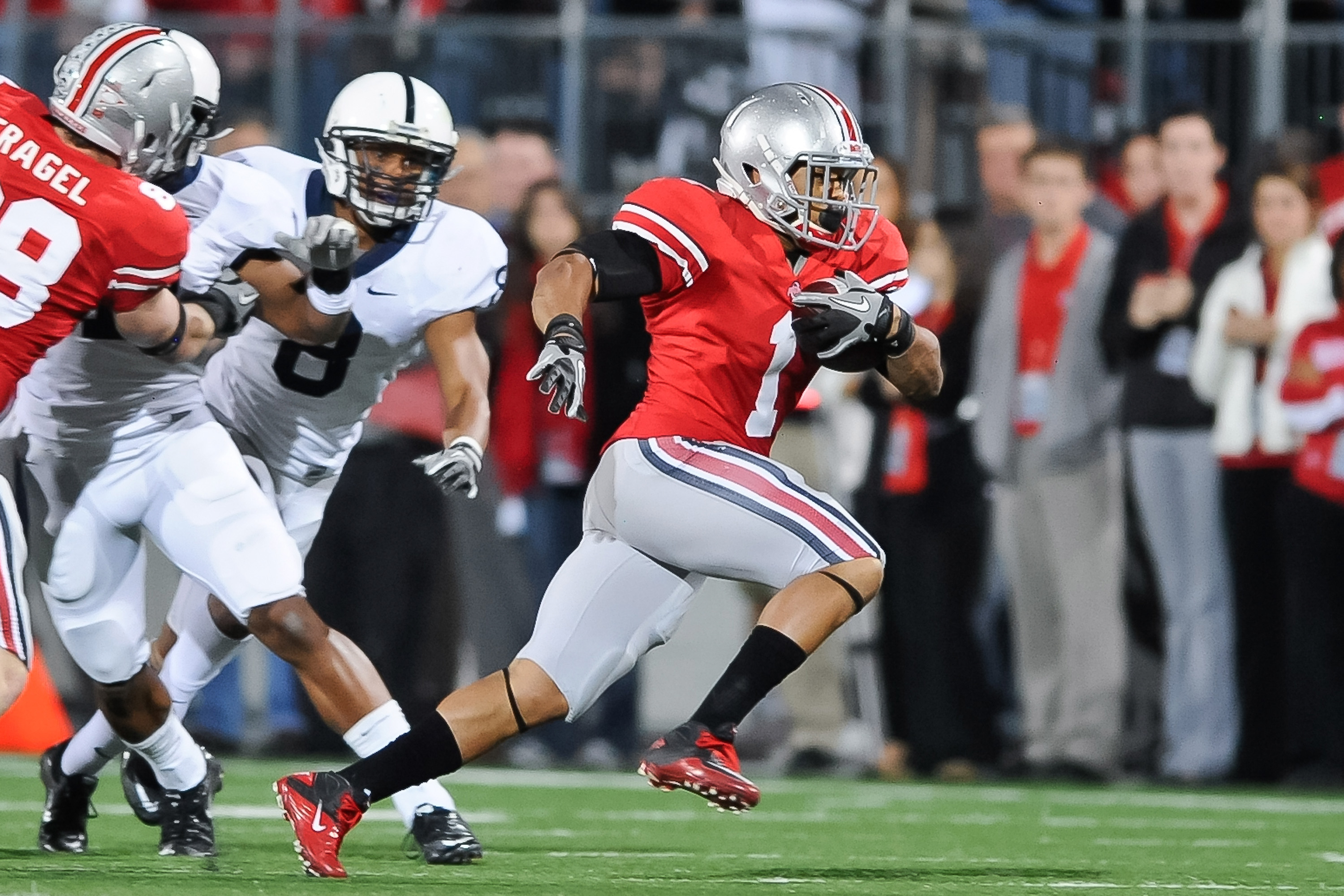 COLUMBUS, OH - NOVEMBER 13:  Dan Herron #1 of the Ohio State Buckeyes runs with the ball against the Penn State Nittany Lions at Ohio Stadium on November 13, 2010 in Columbus, Ohio.  (Photo by Jamie Sabau/Getty Images)