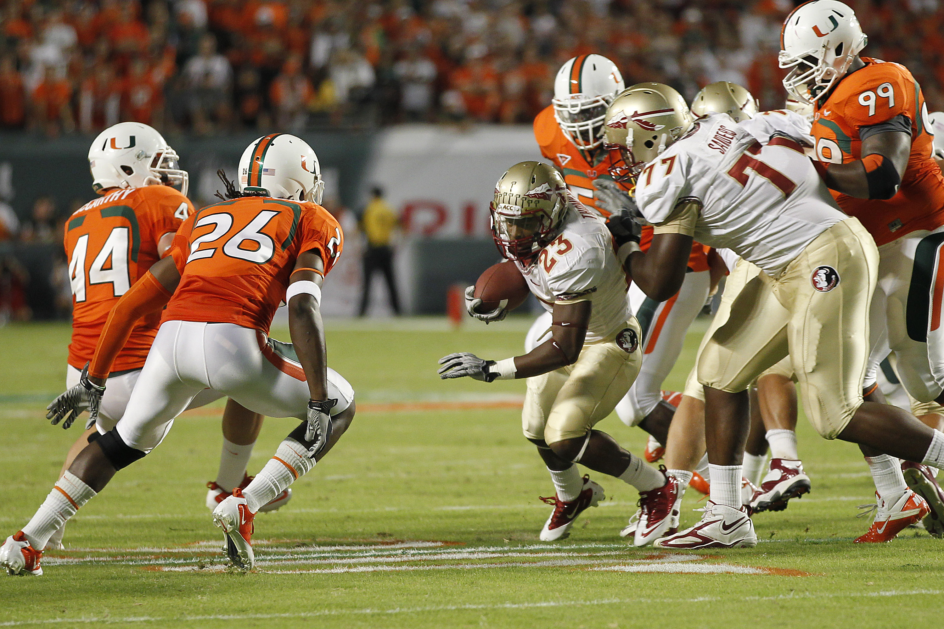 MIAMI, FL - OCTOBER 9: Chris Thompson #23 of the Florida State Seminoles runs with the ball against the Miami Hurricanes on October 9, 2010 at Sun Life Stadium in Miami, Florida. (Photo by Joel Auerbach/Getty Images)