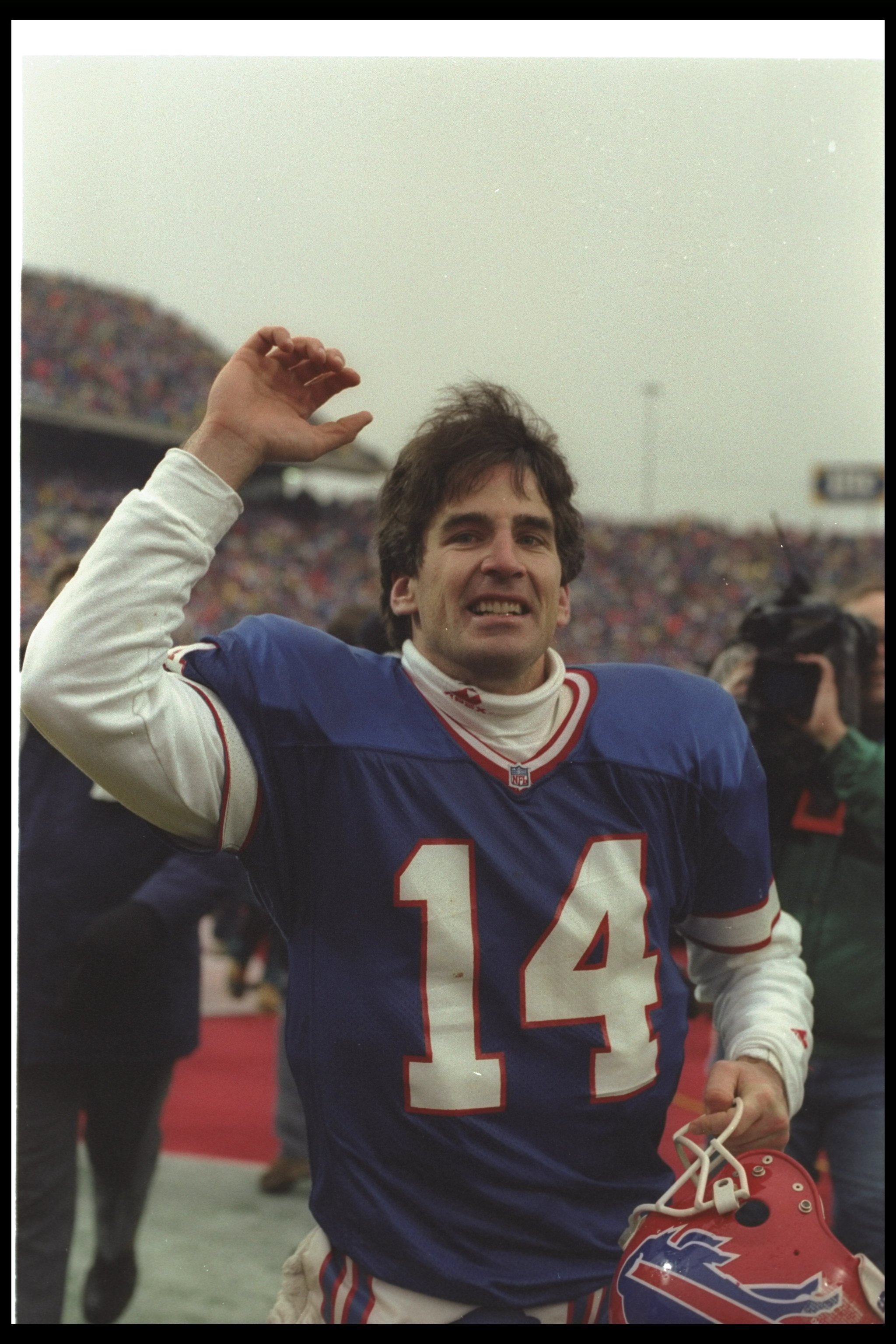 3 Jan 1993: Quarterback Frank Reich of the Buffalo Bills celebrates after a playoff game against the Houston Oilers at Rich Stadium in Orchard Park, New York. The Bills won the game in overtime, 41-38.