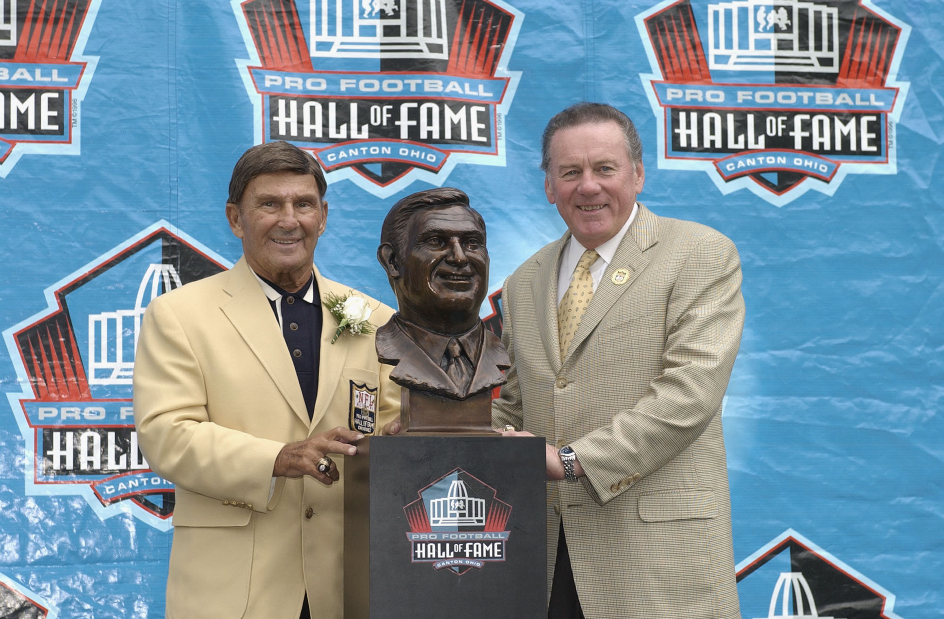 CANTON, OH - AUGUST 3:  Pro Football Hall of Fame inductee Hank Stram (L) poses with his bust and his presenter and fellow Hall of Famer Len Dawson during the 2003 NFL Hall of Fame Induction ceremony on August 3, 2003 in Canton, Ohio.  (Photo by David Max