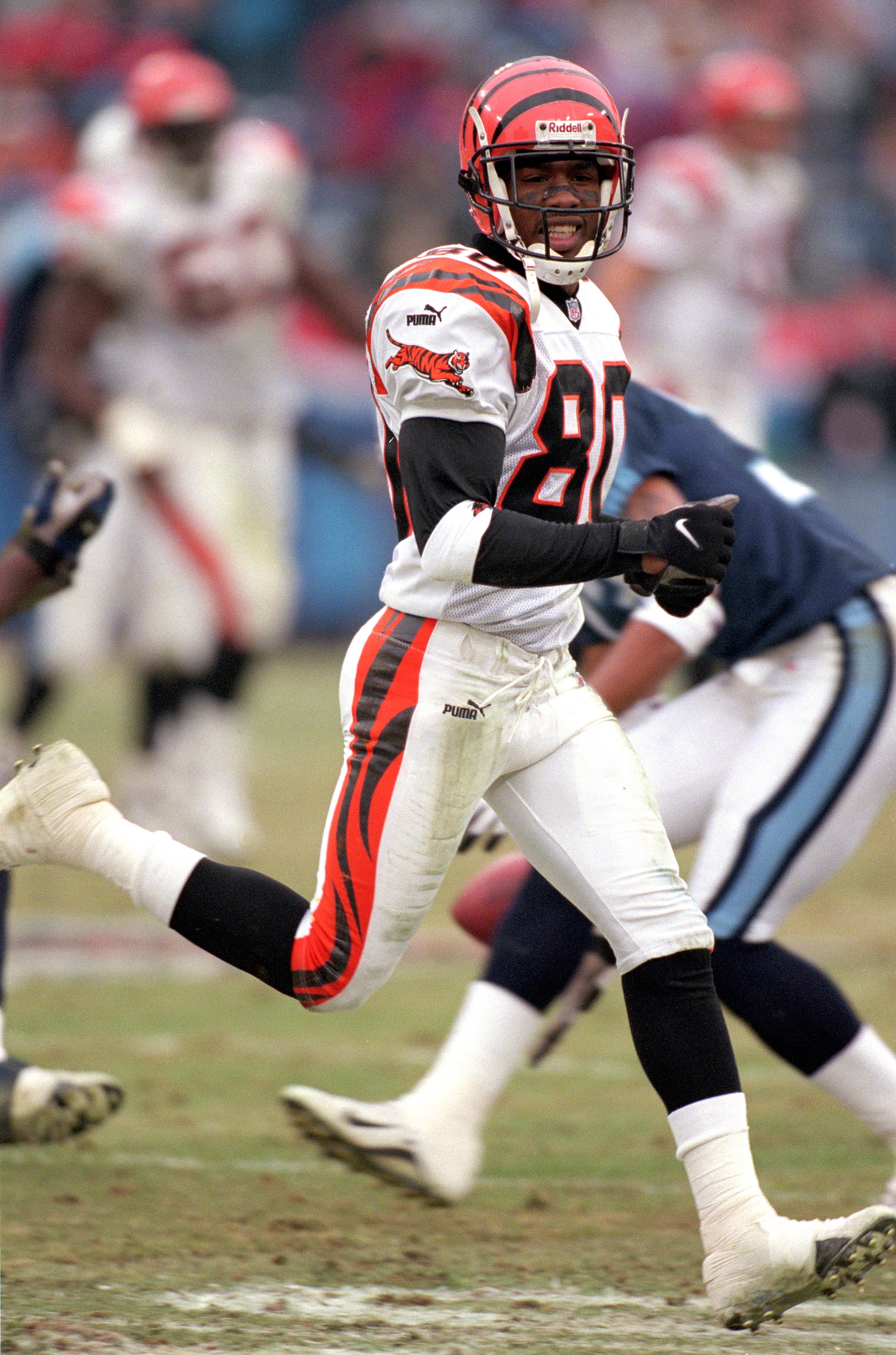 NASHVILLE, TN - DECEMBER 10:  Wide receiver Peter Warrick #80 of the Cincinnati Bengals runs on the field during the game against the Tennessee Titans at Adelphia Coliseum on December 10, 2000 in Nashville, Tennessee.  The Titans defeated the Bengals 35-3